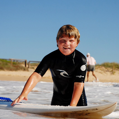 Private Coaching for Kids - Kids will learn, ocean & wave positioning, paddling & catching waves, control, standing up & riding waves. Includes Surf equipment.  Click here to read more...