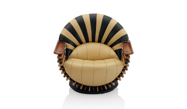 Our husbands loved this Luxor Chair from Pacific Green! We loved the fact that this company provides inspiration and sustainable products and is a benchmark for socially responsible manufacturing. But, it kind of reminded us of a football or maybe a basketball! In fact, we learned that a Los Angeles Laker ordered this chair in purple and gold, the team's colors! Pacific Green furniture is handcrafted and unique, and we admit it is comfy, but we don't want to see it outside of the Man Cave!