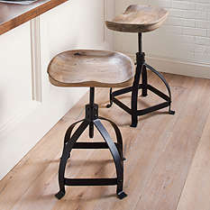 "Finally, for those who may like a rustic farm look, there is the iconic Tractor Swivel Stool!  The hand-carved seat allows for extra comfort and it adjusts to various heights from 20""-28""."