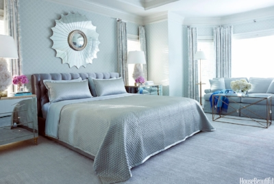 We saw this beautiful smoky blue bedroom in House Beautiful. It was designed by one of our favorite designers, Tobi Fairley, for a client who wanted a little bit of Hollywood glam with a soft and airy color scheme.
