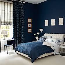 We saw this bedroom on Pinterest, and loved the contrast between the dark blue walls, bedding, and window treatments and the light carpeting and tufted headboard.