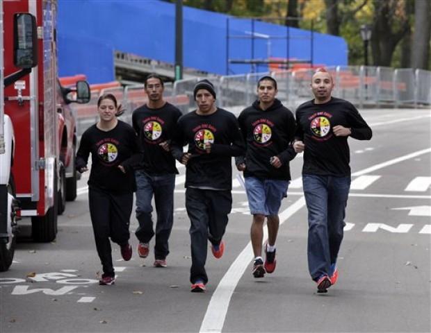 A team of Lakota runners from the Pine Ridge reservation preparing to race.(AP/Richard Drew)