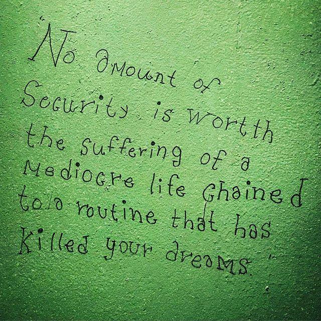 Bathroom wall wisdom.