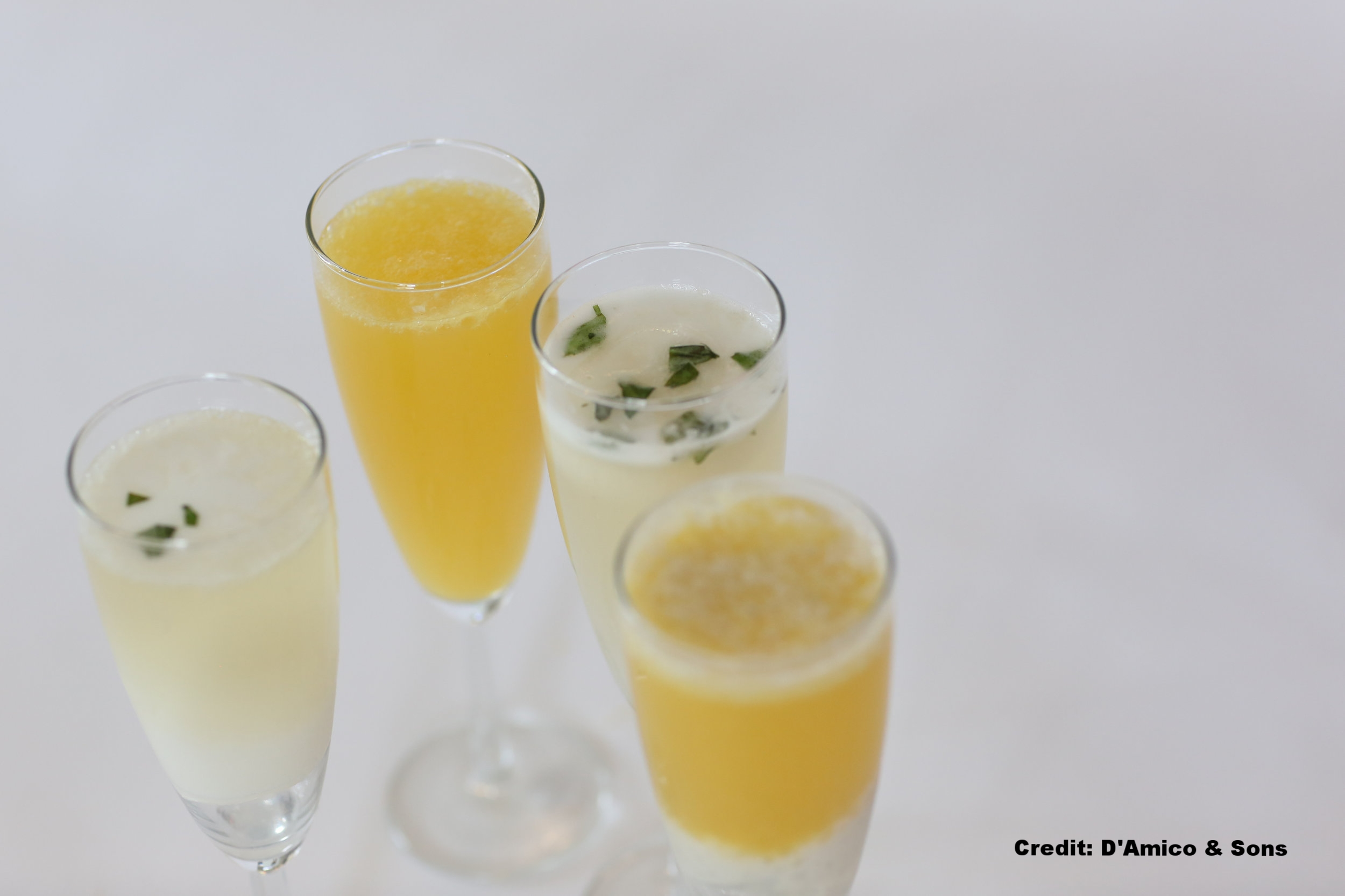 Mimosa, orange cream mimosa and Sgroppino, a house-made basil lemonade champagne spritz with Izzy's lemon basil sorbetto.jpg