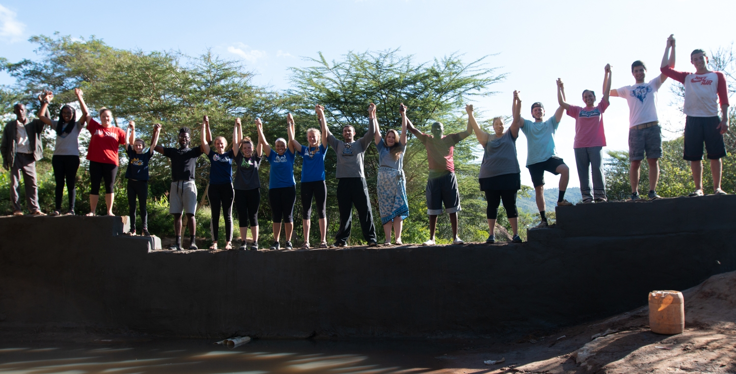 Eastern Mennonite University sends a group of students to Kyangala Village to work with the community to build a sand dam.  This fills the cross cultural requirements for the students.