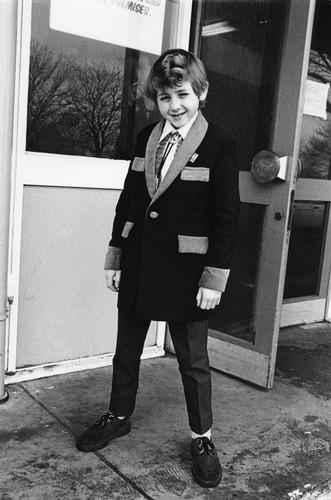 A kid wearing Teddy Boy styles, Caister weekender, UK 1980. ©Janette Beckman / PYMCA