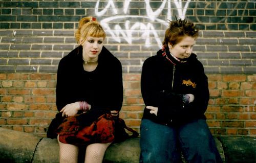 Bored looking teenagers, in Rock/Metal style, Camden 2001. ©Adrian Fisk/PYMCA