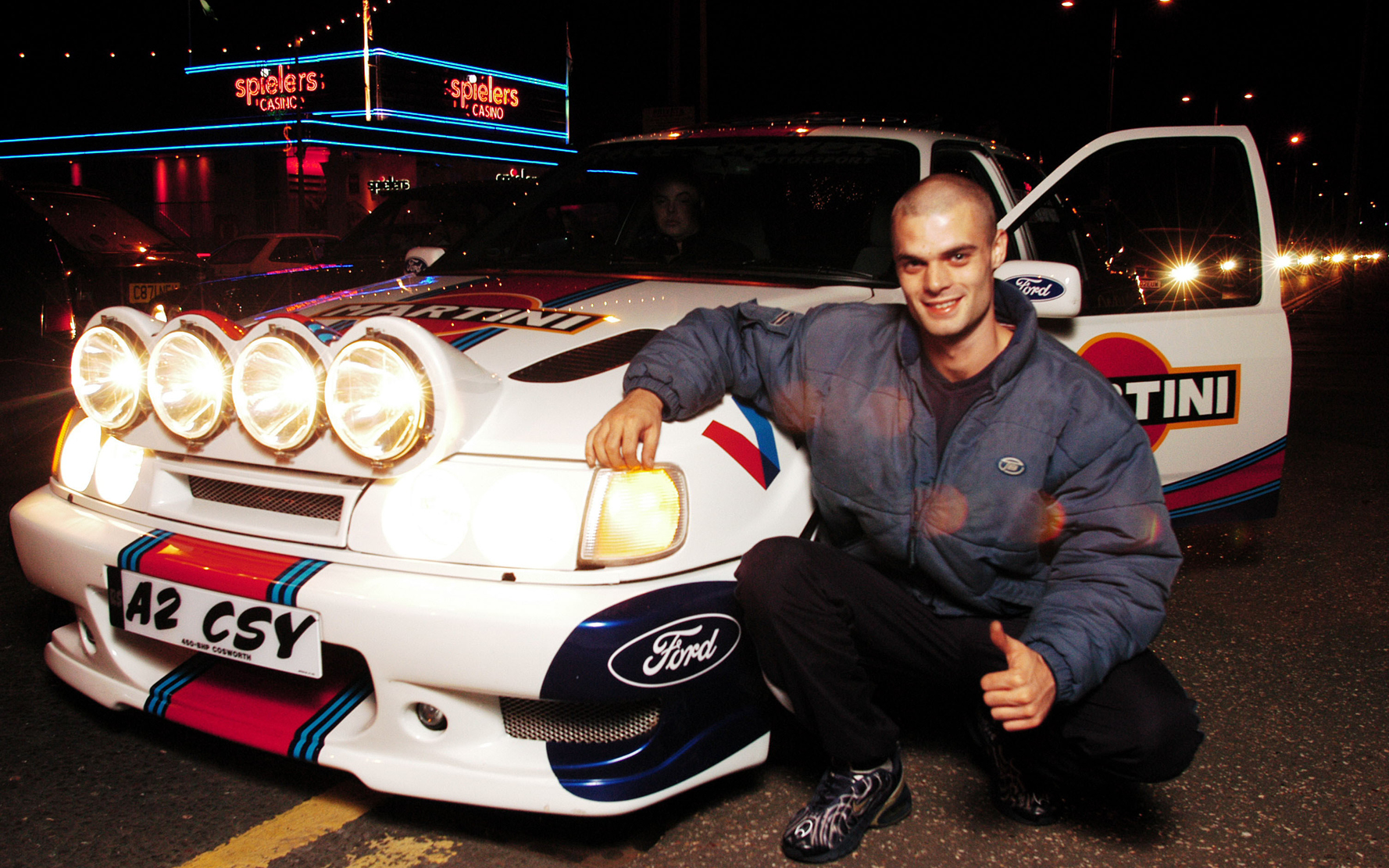 A boy racer posing by his customised Cosworth, Southend, Basildon, 2002   ©   Nick Cunard   / PYMCA