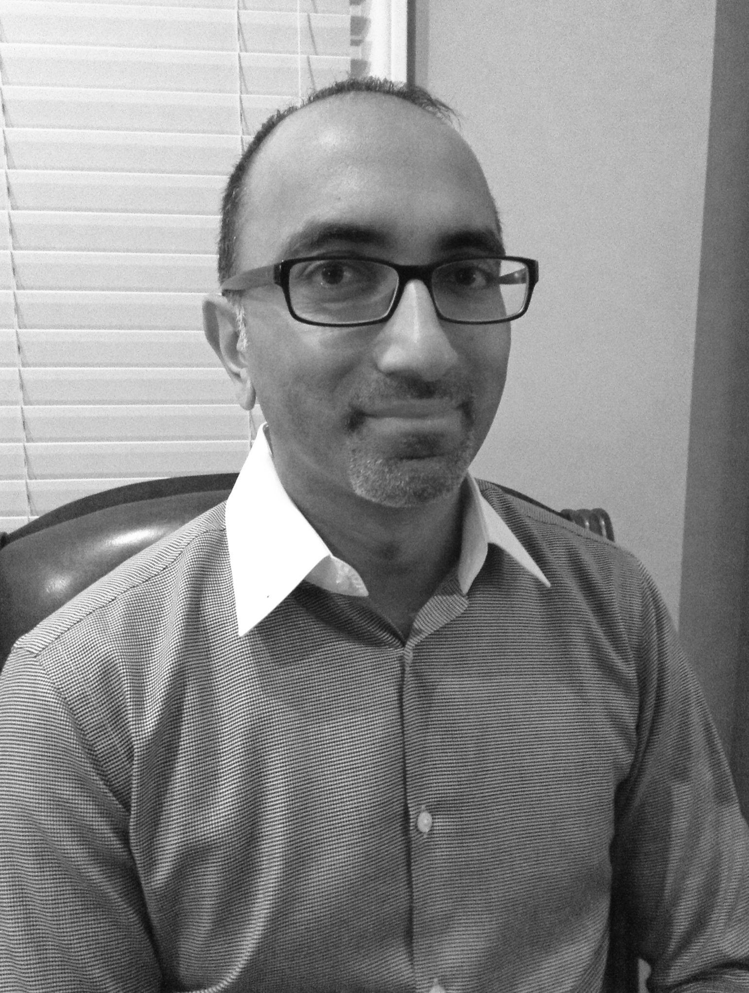 """Vik Reddy is a practicing plastic surgeon and a regular contributor to the *Detroit Free Press*. He serves as the Medical Director of Quality at Henry Ford Macomb Hospital. Read his piece, """" Stuck """" in the Spring 2015 Intima."""