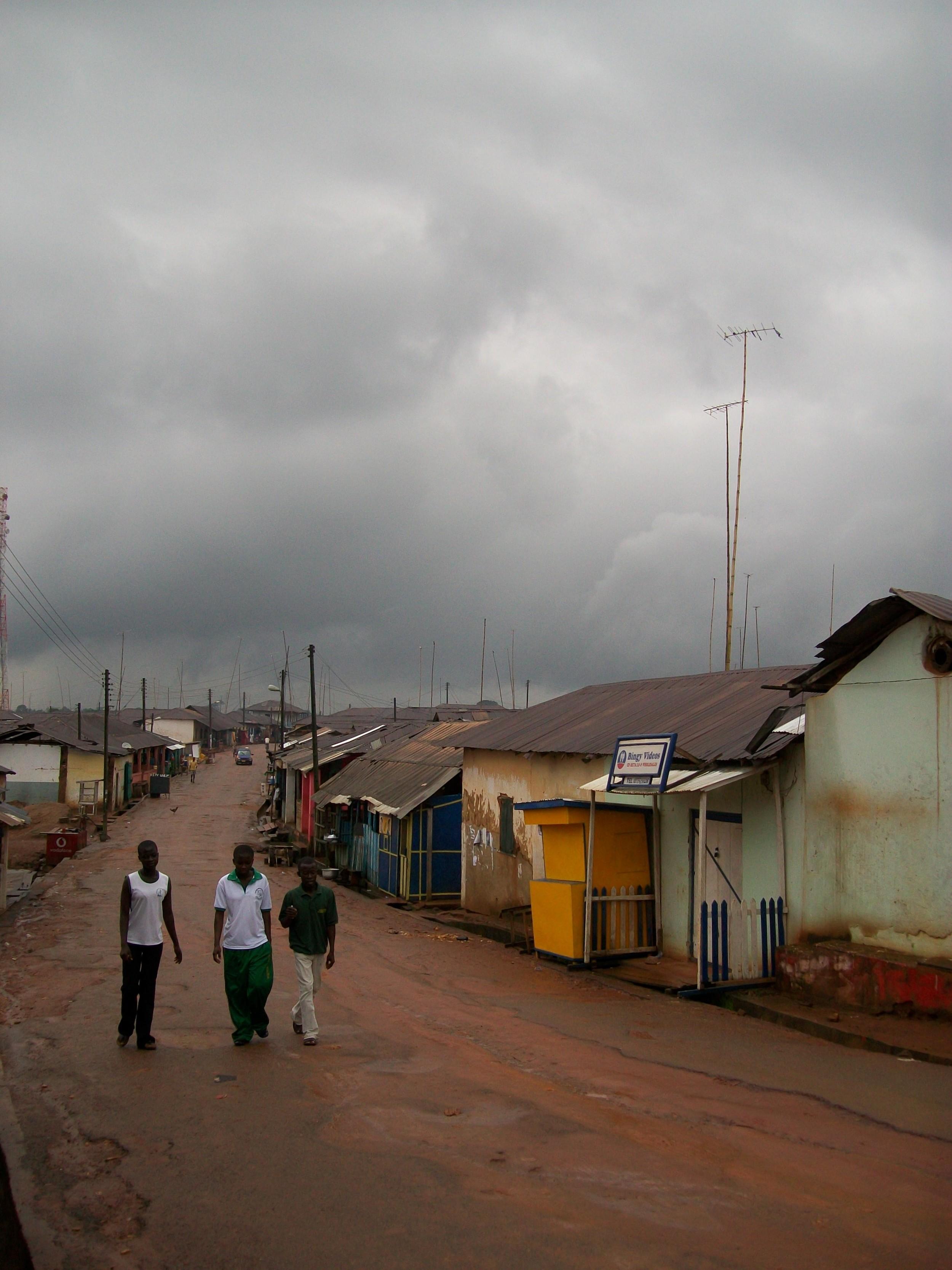 A street scene in rural Central Region, Ghana, before a rainstorm, 2010.  Photo by M. Sophia Newman