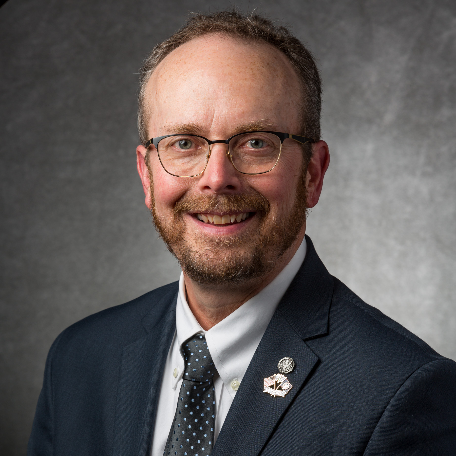 """Michael Brown is an optometrist who has practiced with the U.S. Department of Veterans Affairs for over 25 years and served as an adjunct clinical professor at the University of Alabama at Birmingham School of Optometry. His piece, """" Red Line Rising ,"""" appears in the the Spring 2018 Intima: A Journal of Narrative Medicine"""