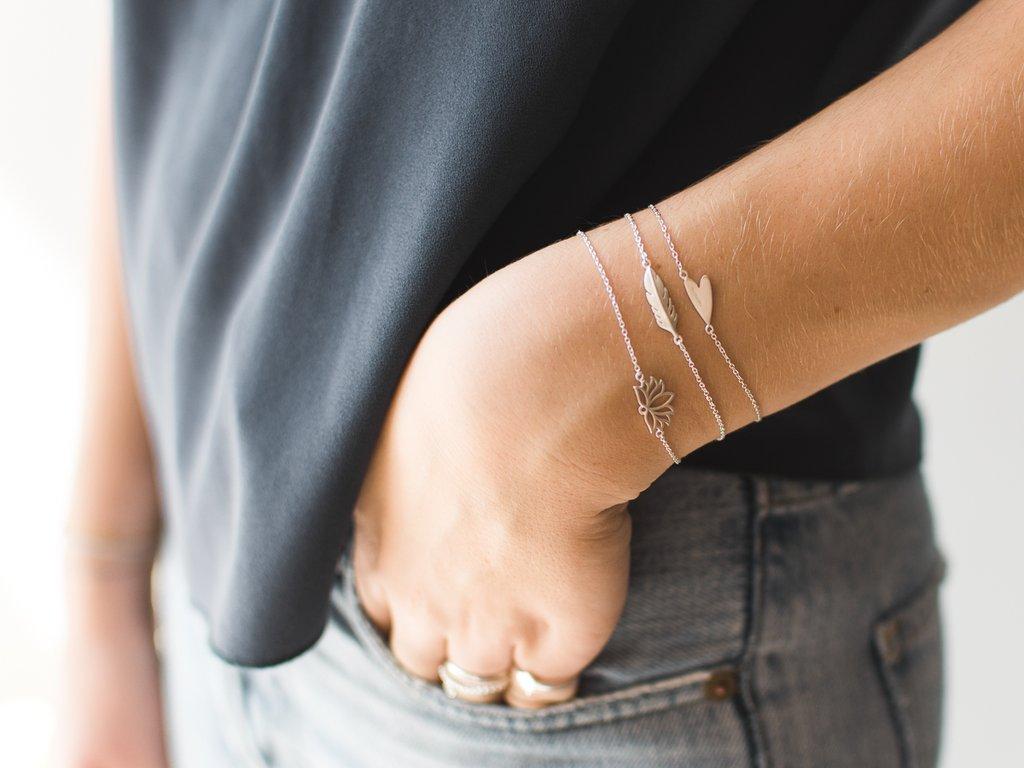 feather bracelet worn.jpg