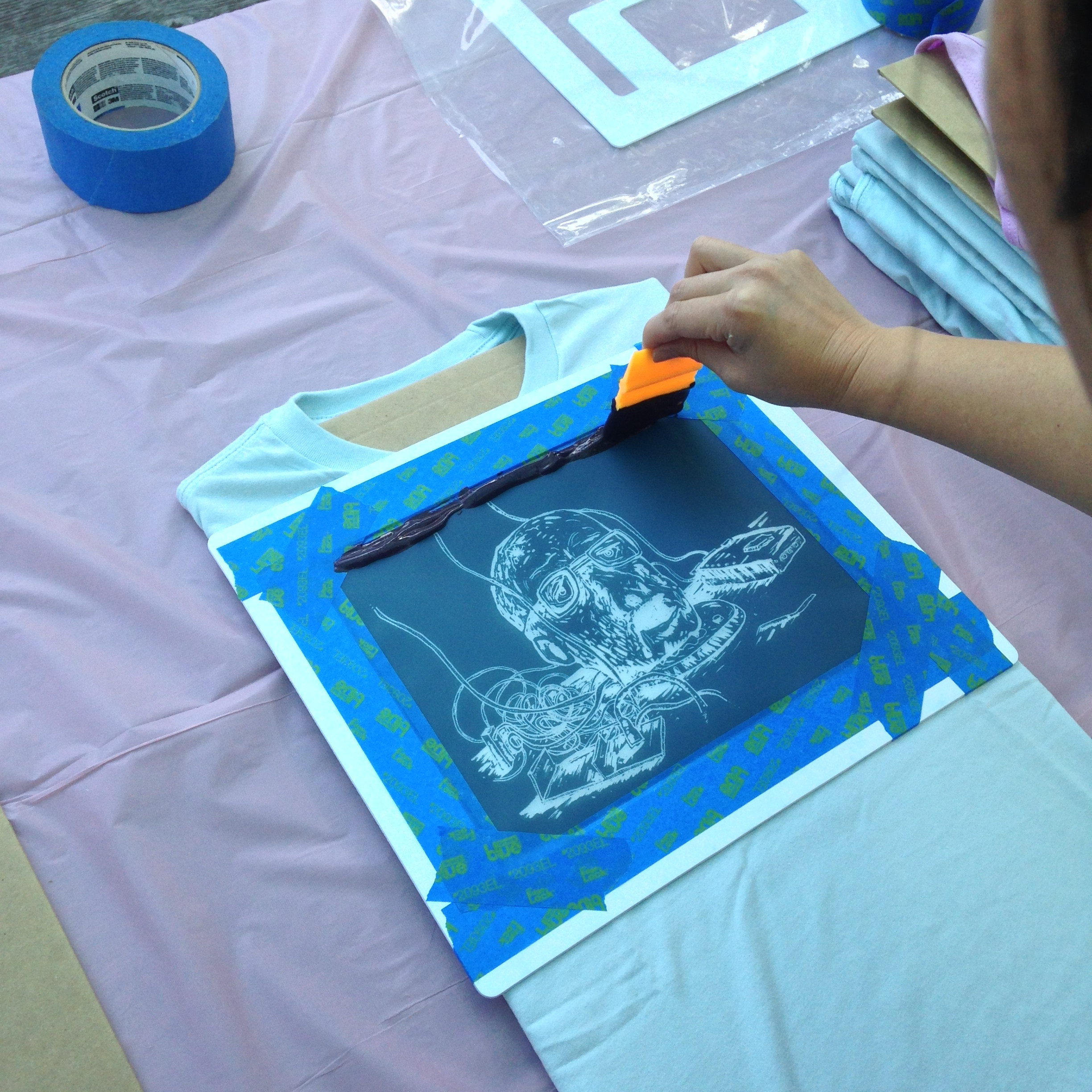 It takes a steady hand to smooth out that ink when screen printing one at a time.