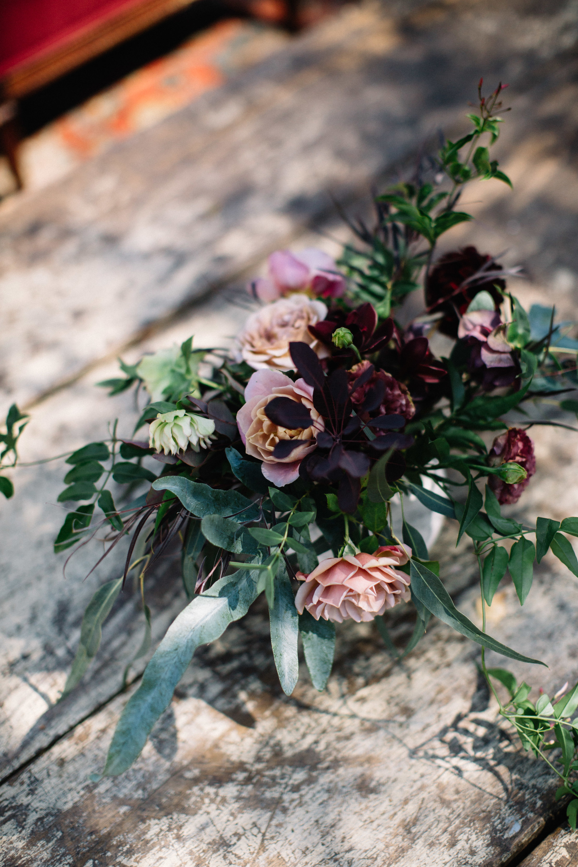Sonoma Coast wedding flowers with Distant Drums Garden Roses, Hellebores, Blue Star Ferns, Orchids, Jasmine Vine and more by Venn Floral photographed by Lucille Lawrence in Northern California at Straus Home Ranch wedding venue.
