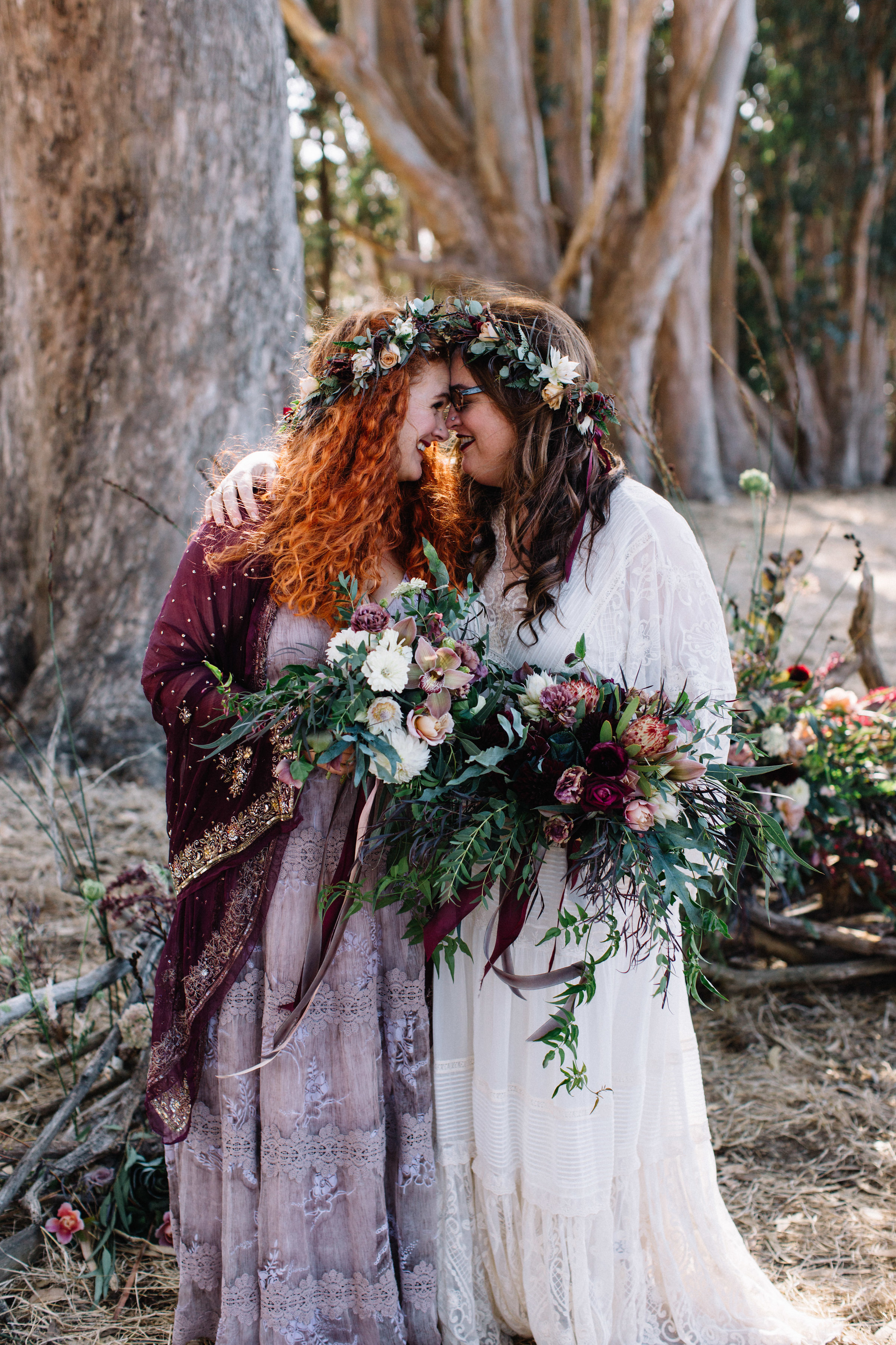 Elegant floral crowns and bouquets by Venn Floral with garden roses, hellebores, jasmine, and ferns at an outdoor wedding photographed by Lucille Lawrence at Straus Home Ranch in Marshall, California on the TOmales Bay.