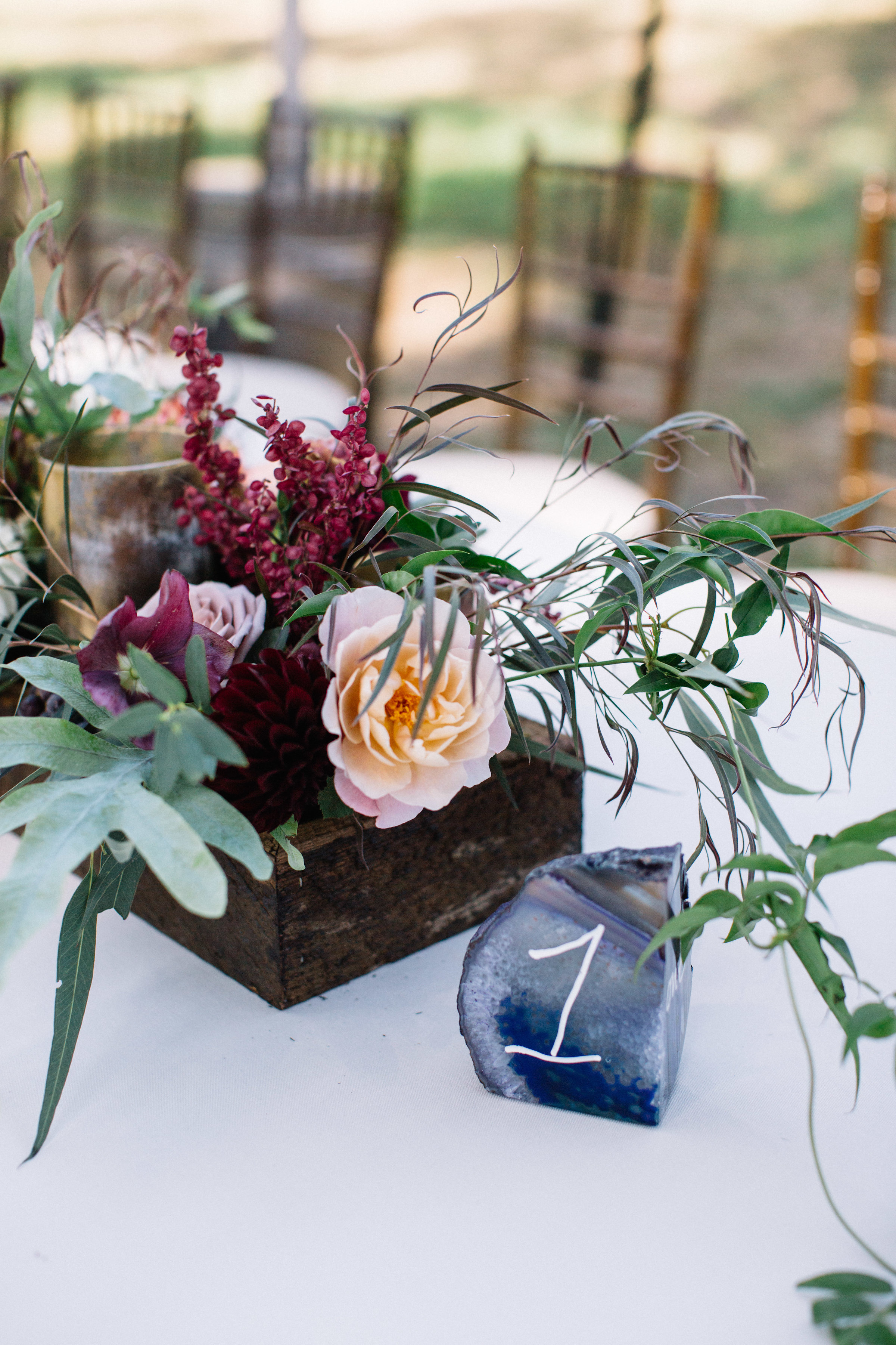 Tablescape with geodes, crystals , flowers, and candles by Venn Floral photographed by Lucille Lawrence in Northern California at Straus Home Ranch.