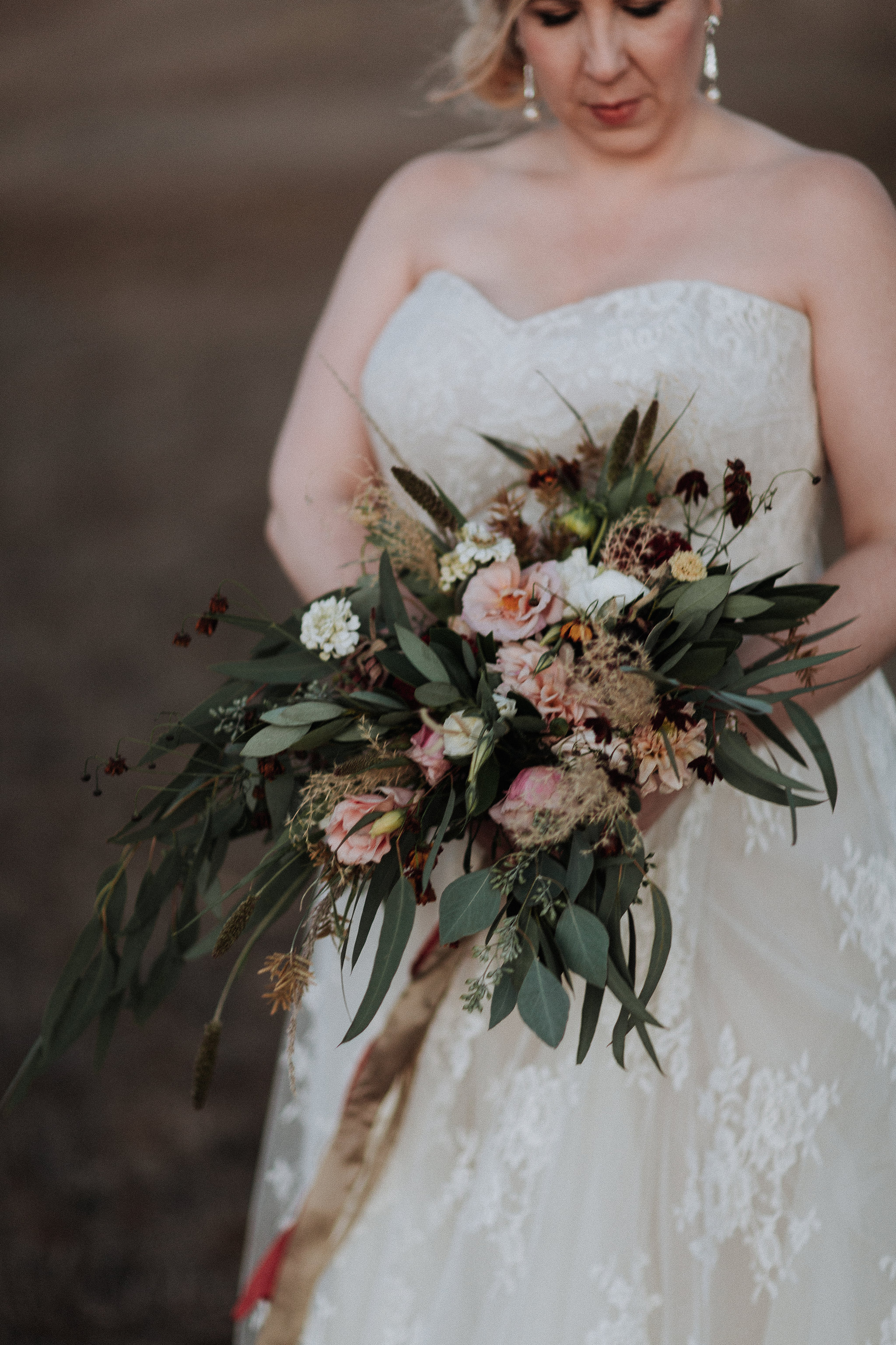 Wild an textural bridal bouquet with local flowers in shades of rose, gold, sage, and burgundy by Venn Floral at Olympia's Valley Estate with Ooh La La Weddings photographed by Gretchen Gause.