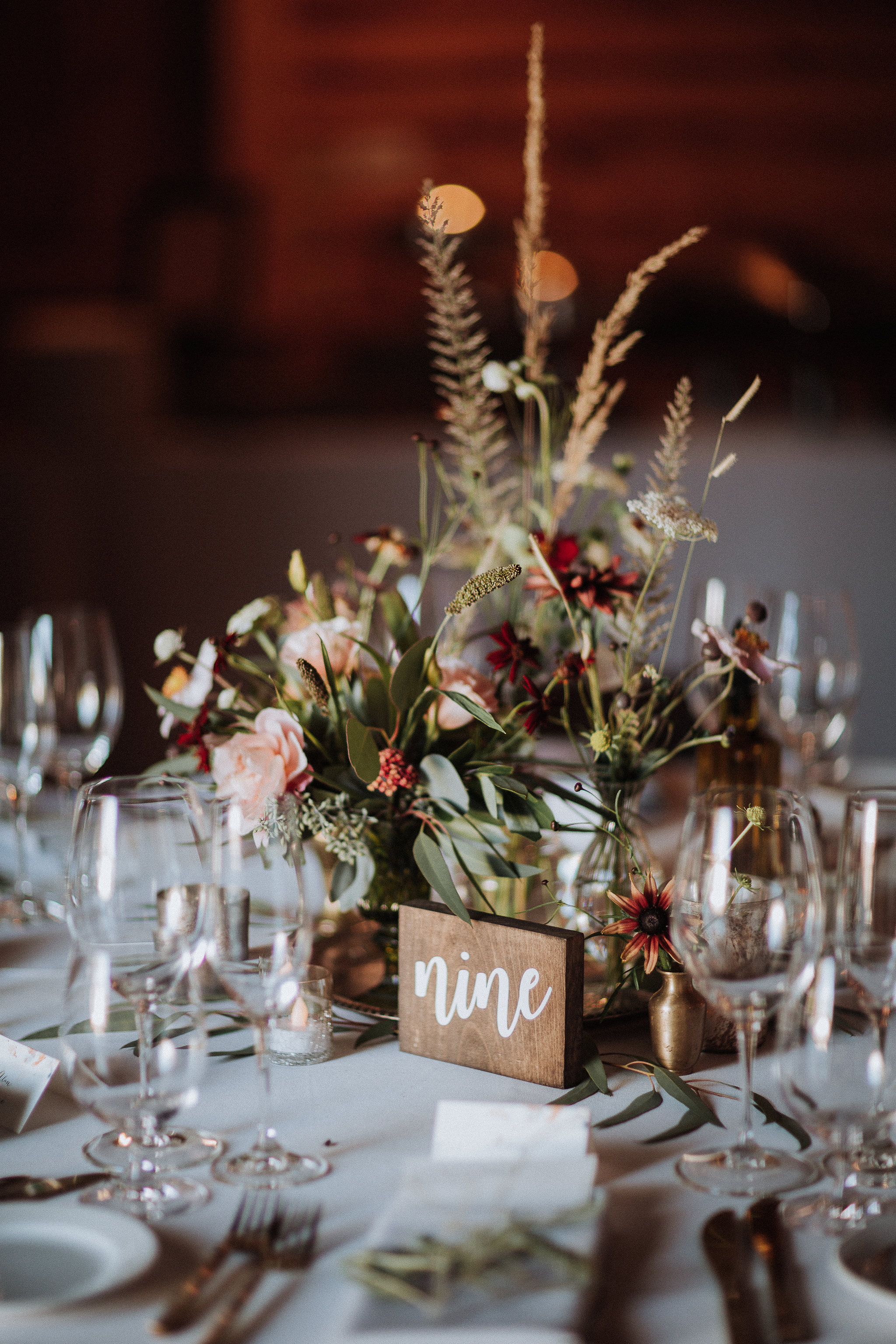Centerpiece vignette with vintage brass bud vases and autumn flowers by Venn Floral at Olympia's Valley Estate with Ooh La La Weddings and Events photographed by Gretchen Gause.
