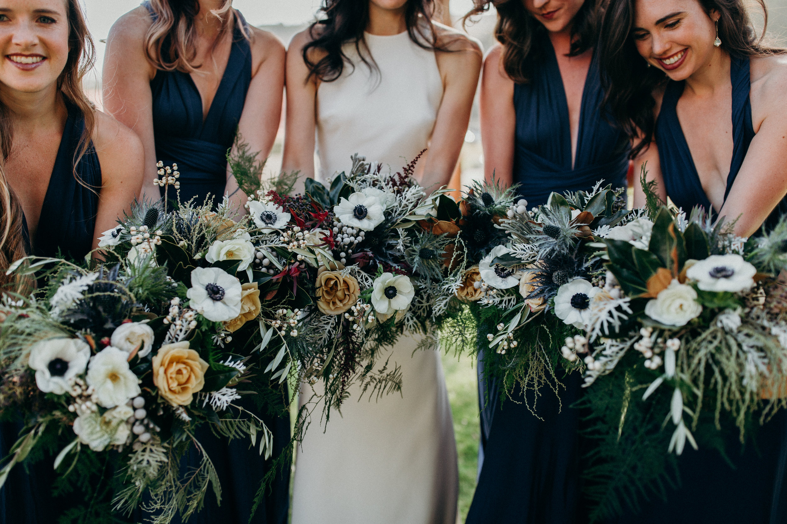 Natural bridal bouquets in white, gold, navy, and light burgundy by Venn Floral at Cavallo Point photographed by Ryan Chard Smith.