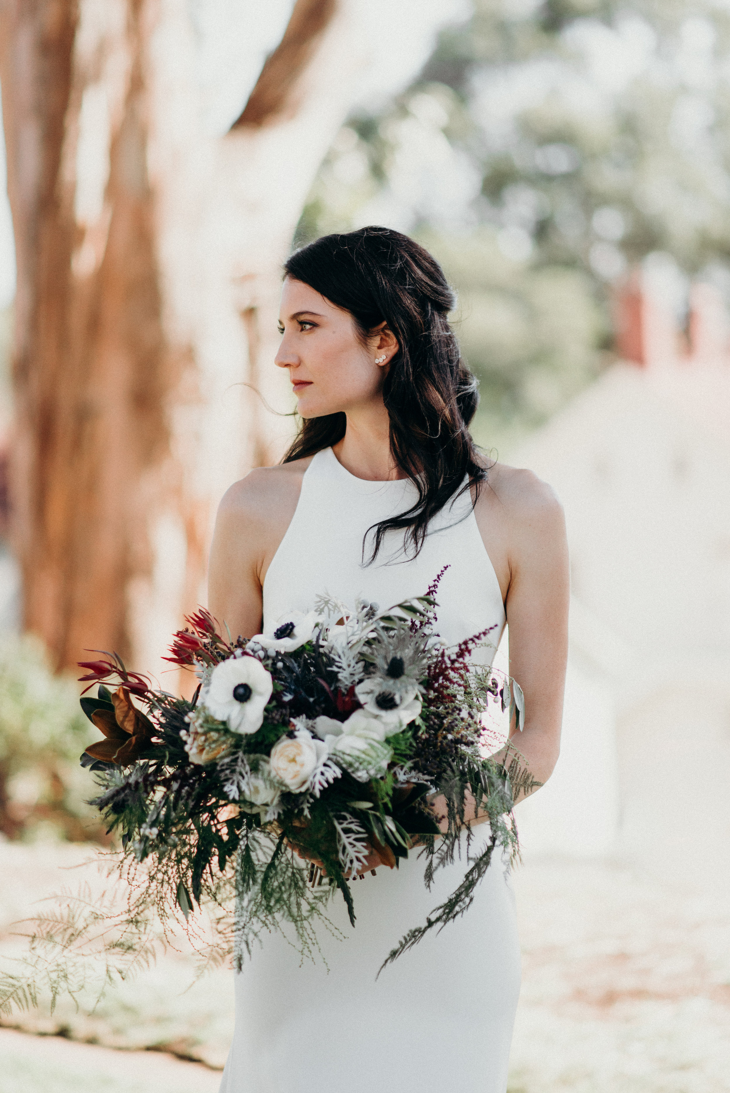 Natural bouquet by Venn Floral at Cavallo Point photographed by Ryan Chard Smith. Featuring soft white, cream, gold, navy, and light burgundy.