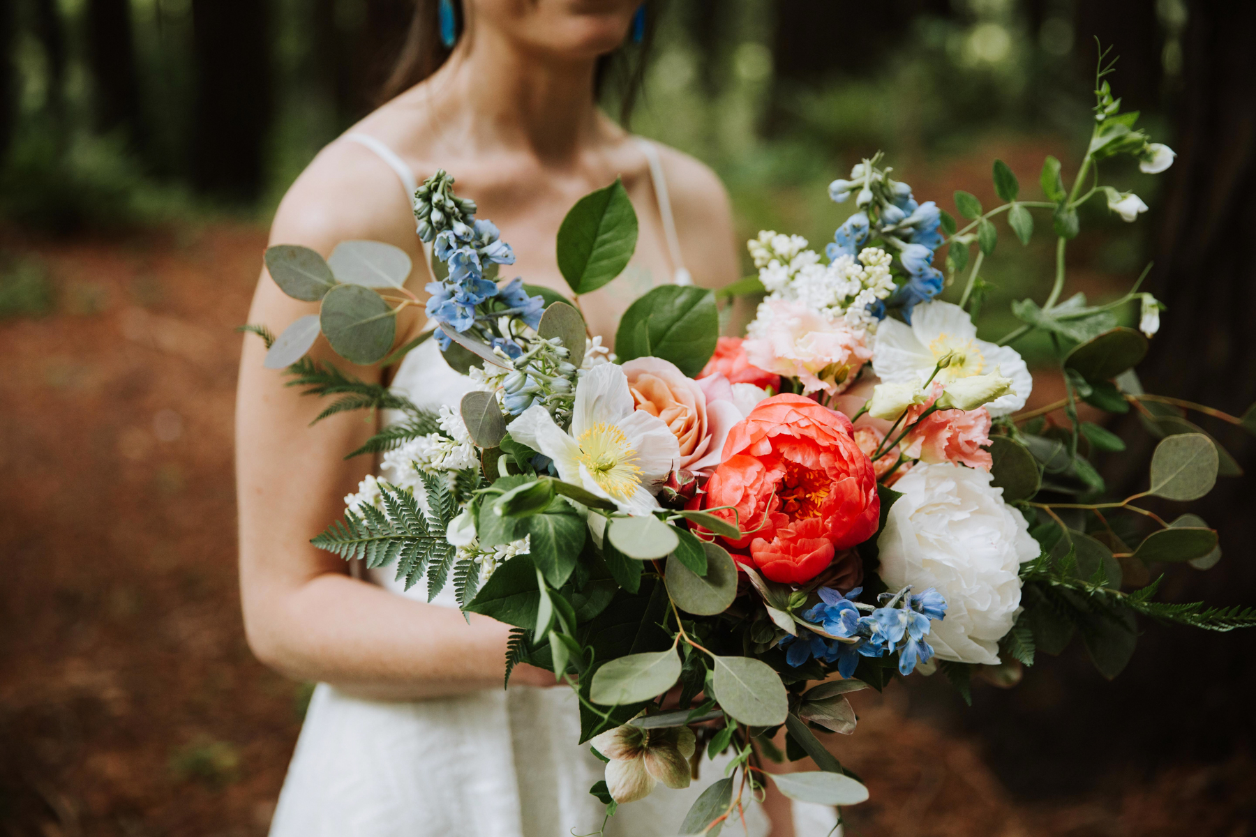 Colorful spring Bridal bouquet by Venn Floral photographed by Andria Lo at the UC Berkeley Botanical Gardens Redwood Grove with Lily Spruce.