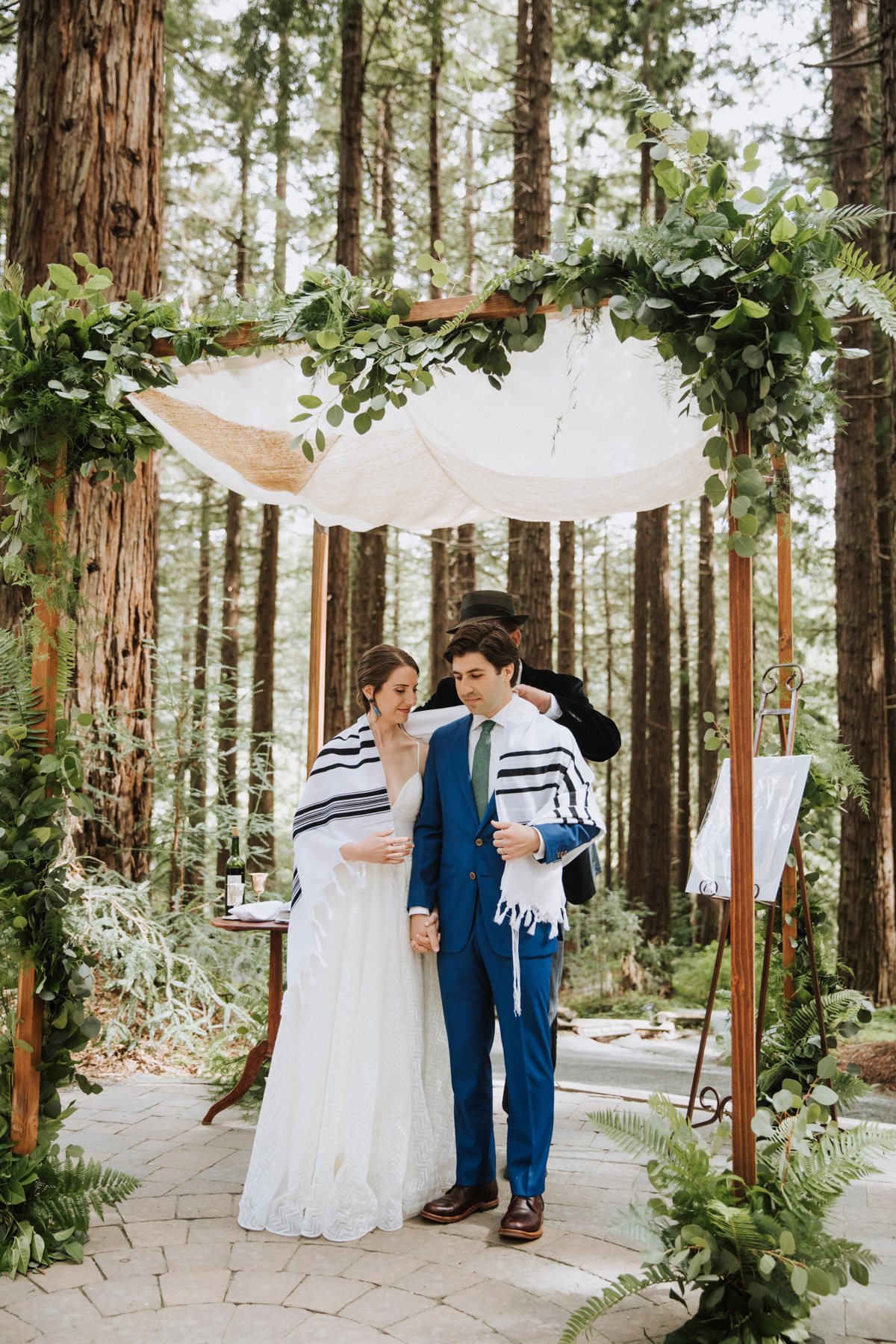 Wild greenery and fern chuppah decor by Venn Floral photographed by Andria Lo in Berkeley, California with Lily Spruce.
