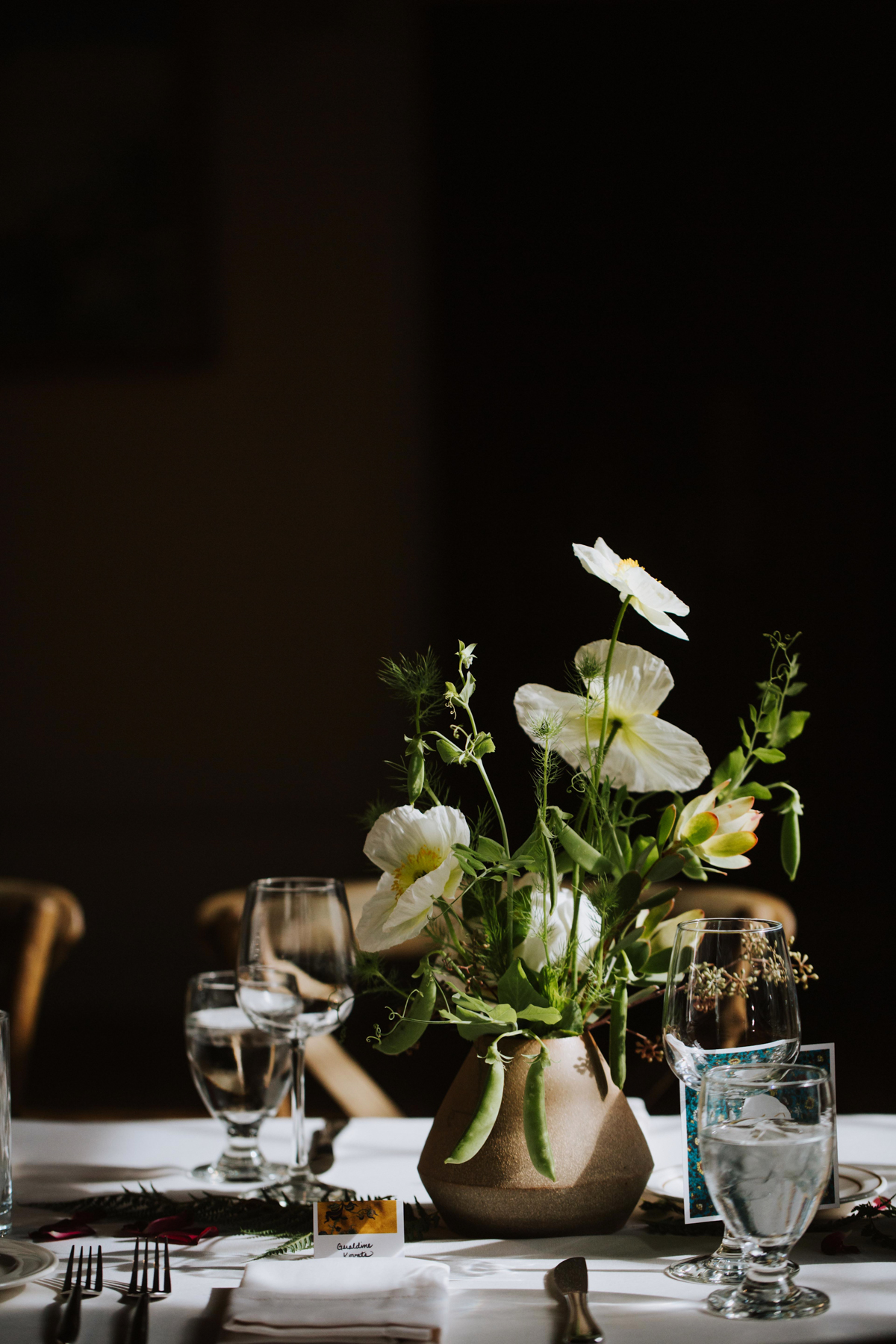 Spring centerpieces by Venn Floral with poppies, peas, and hellebores photographed by Andria Lo at The Berkely City Club, a gorgeous Julia Morgan building with eclectic antique decor and a Wes Anderson vibe.
