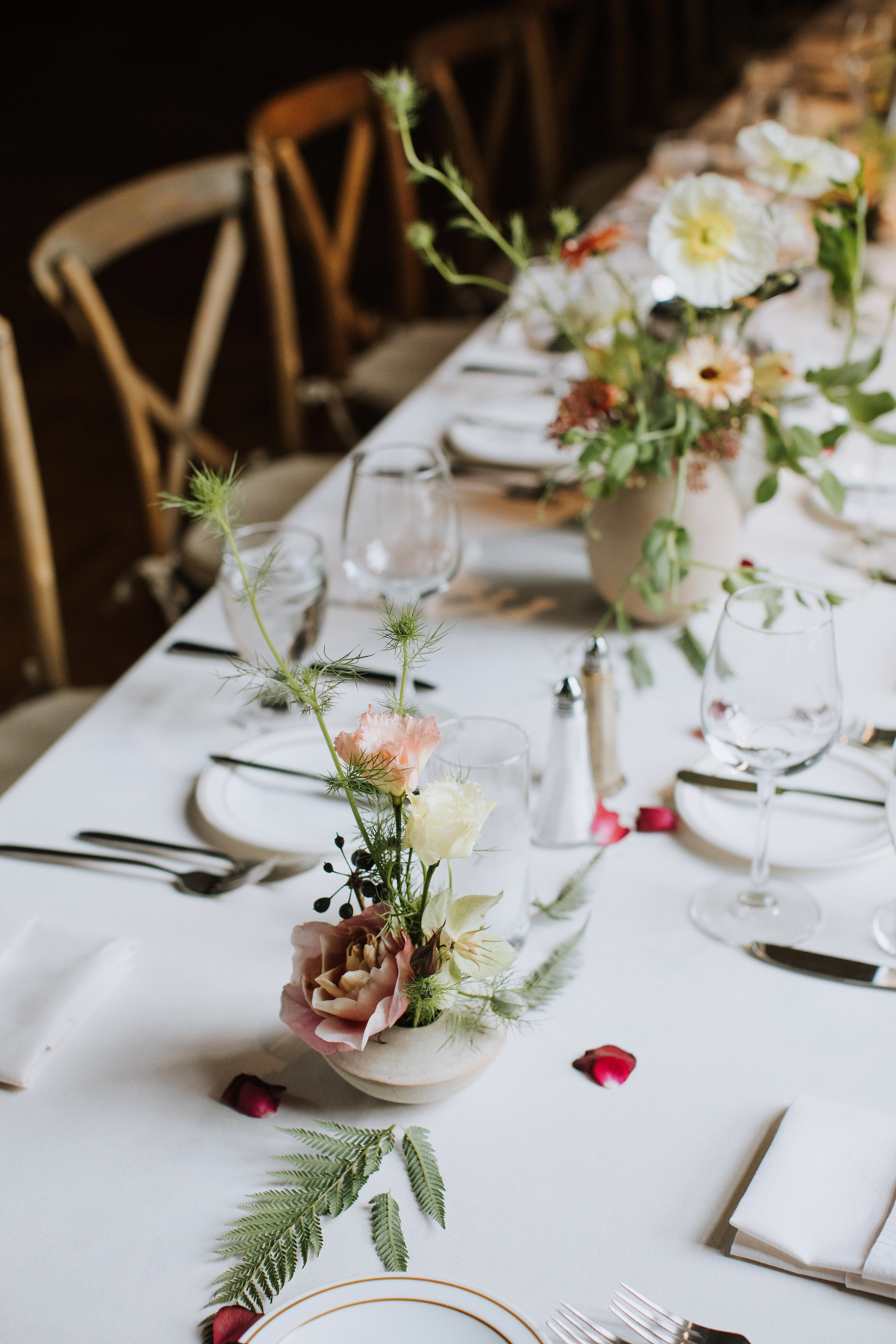 Spring centerpieces by Venn Floral with poppies, roses, ferns, and hellebores photographed by Andria Lo at The Berkely City Club, a gorgeous Julia Morgan building with eclectic antique decor and a Wes Anderson vibe.