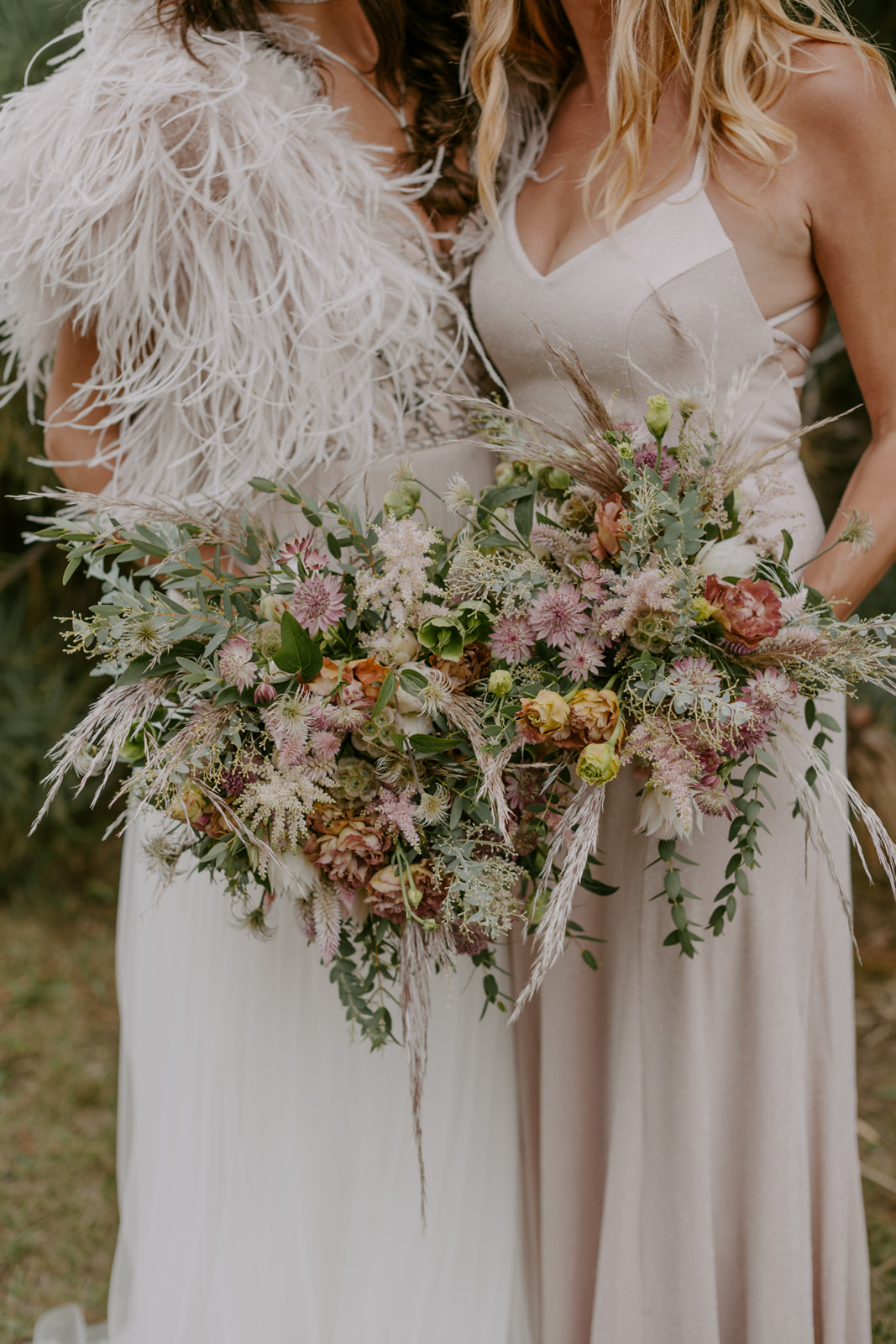 Earthy textural flower bouquets with Astrantia, Hellebore, Astilbe, Pink Pampas Grass, Eucalyptus, Blushing Bride, and Lisianthus by Venn Floral photographed by Kristen Marie Parker.