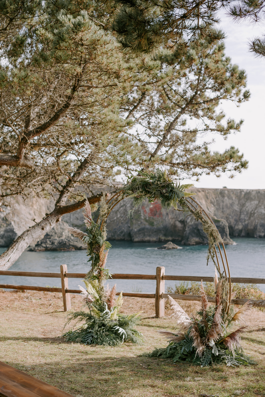 Circular ceremony arch with pampas grass, ferns, and airplants for an intimate Northern California wedding with Venn Floral and Kristen Marie Parker.