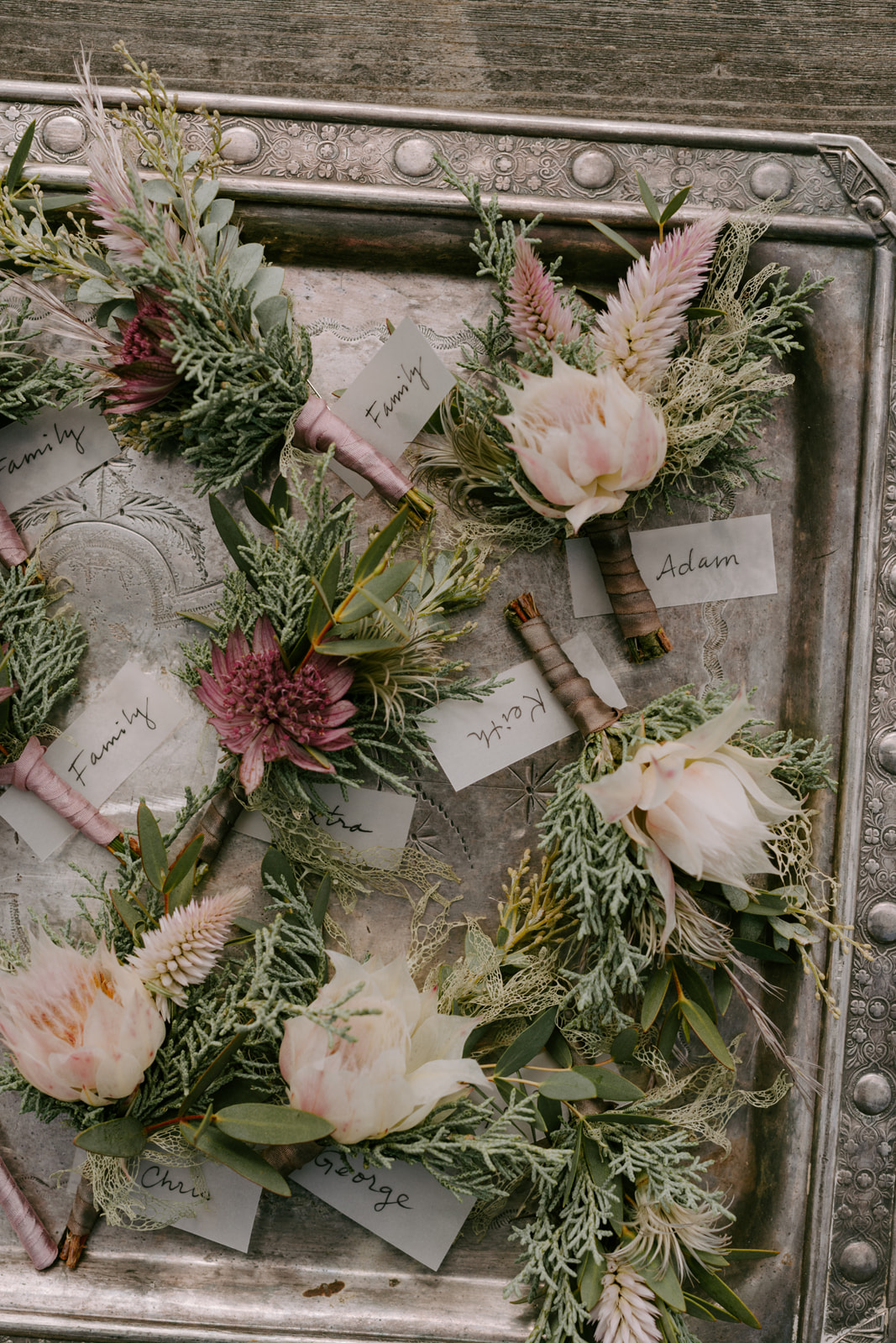 Romantic greenery boutonnieres by Venn Floral photographed by Kristen Marie Parker at Heritage House Resort on the Mendocino Coast.