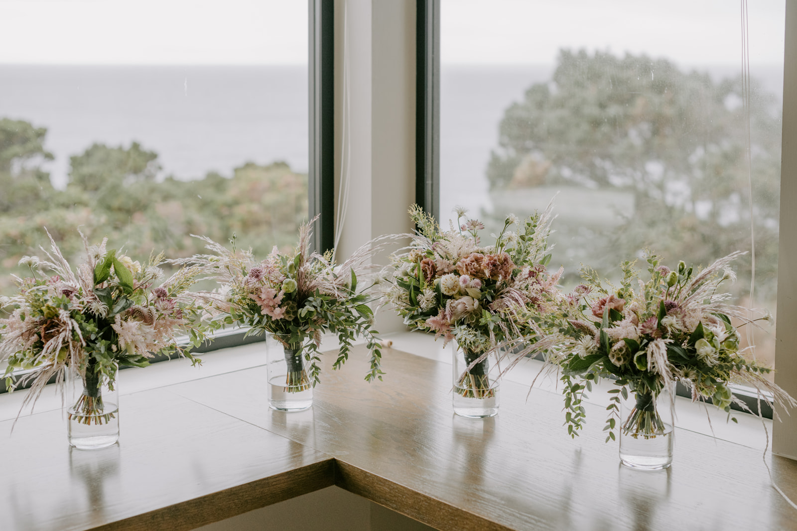 Pink pampas grass bouquets for a coastal wedding party with Venn Floral and Kristen Marie Parker.