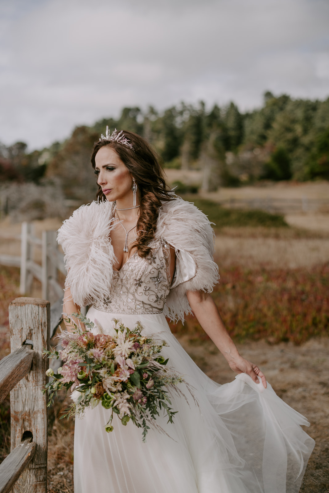 Venn Floral's stylish autumn bride on the Mendocino Coast with her quartz crown, feather shawl and textural bouquet photographed by Kristen Marie Parker.