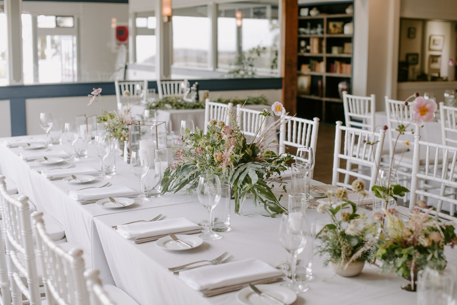 Fern, Anemone, Pampas Grass, Hellebore centerpieces for an earthy and wild wedding celebration at Heritage House Resort by Venn Floral photography by Kristen Marie Parker.