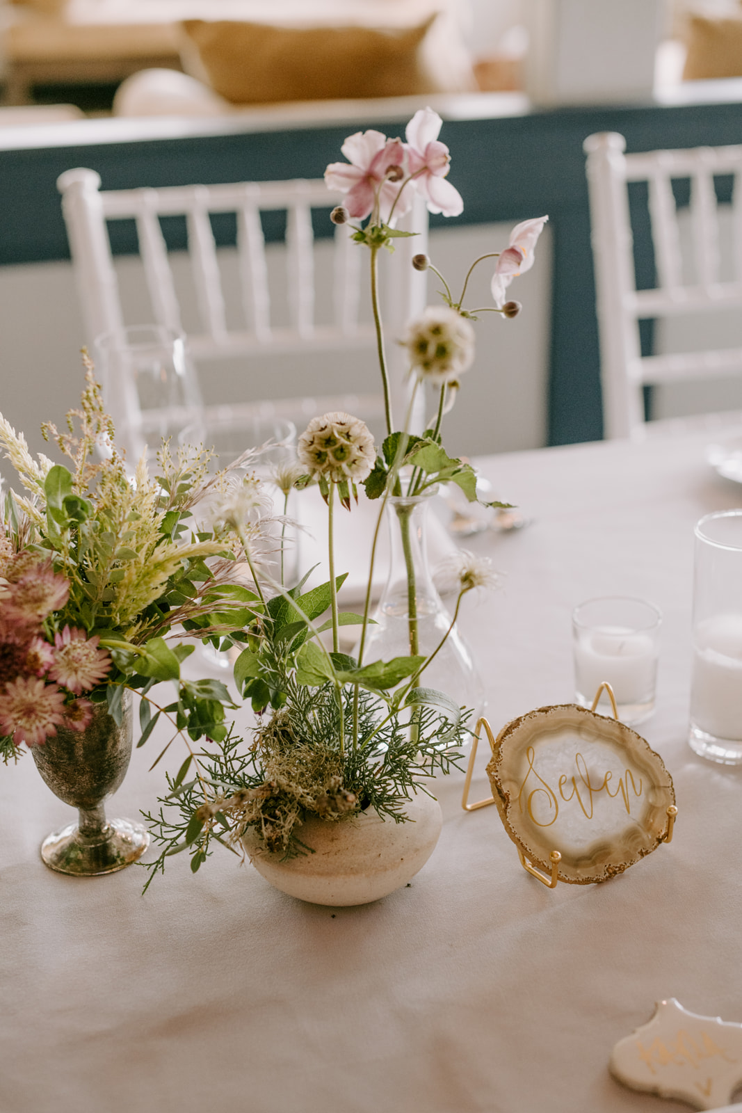 Romantic textural centerpieces by Venn Floral in vase by Nedda Atassi photographed by Kristen Marie Parker.