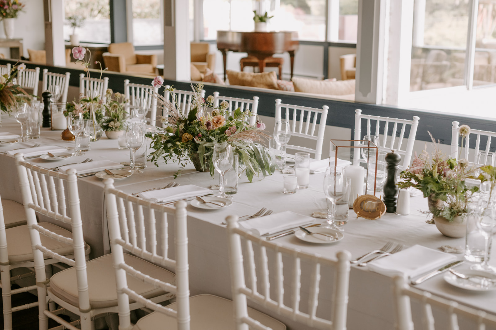 Earthy modern tablescape in soft tones of blush, apricot, and light green by Venn Floral photographed by Kristen Marie Parker.