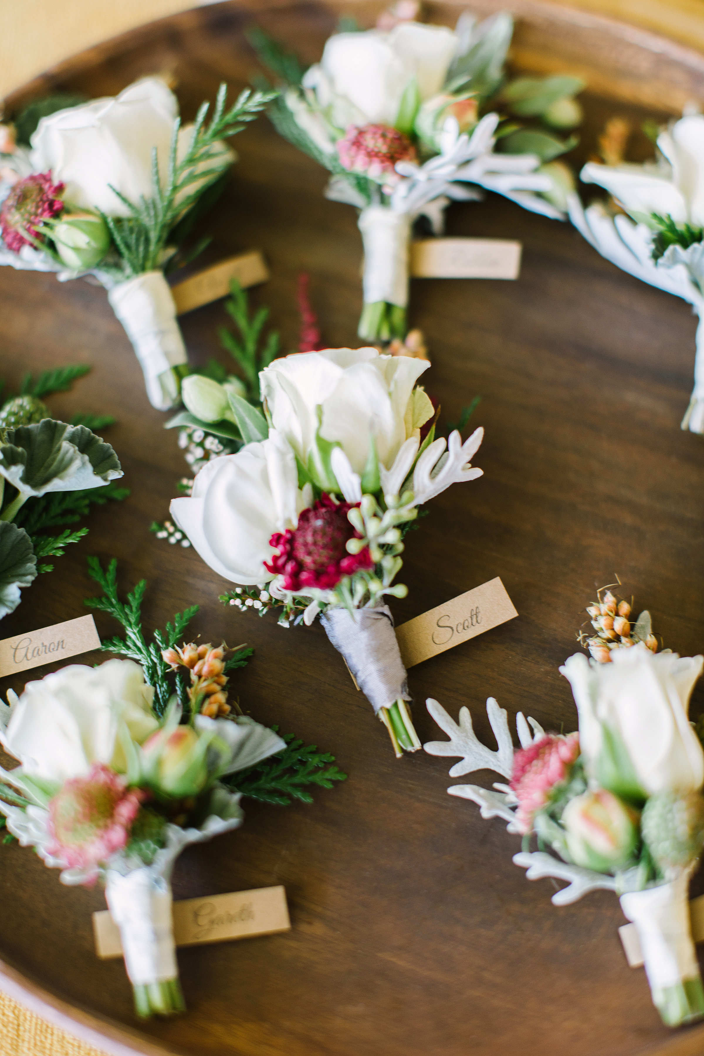 Earthy and neutral boutonnieres with grey silk ribbon by Venn Floral at Olympia's Valley Estate photographed by The Edges