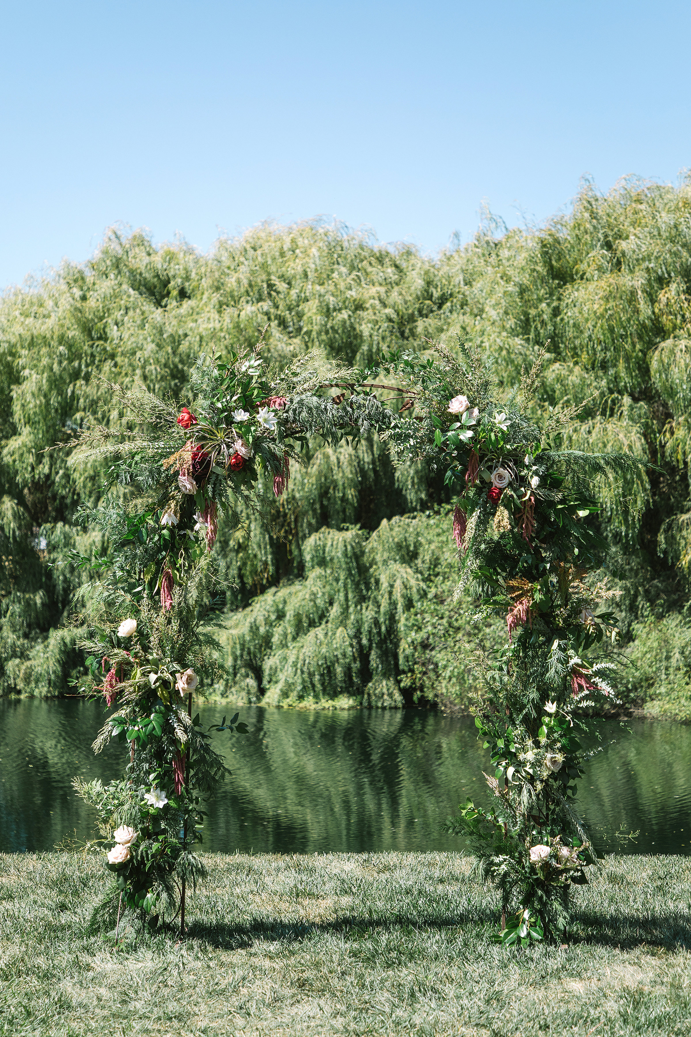 Floral Wedding Arch with Roses, Vines and Berries by Venn Floral at Olympia's Valley Estate in Petaluma photographed by The Edges.
