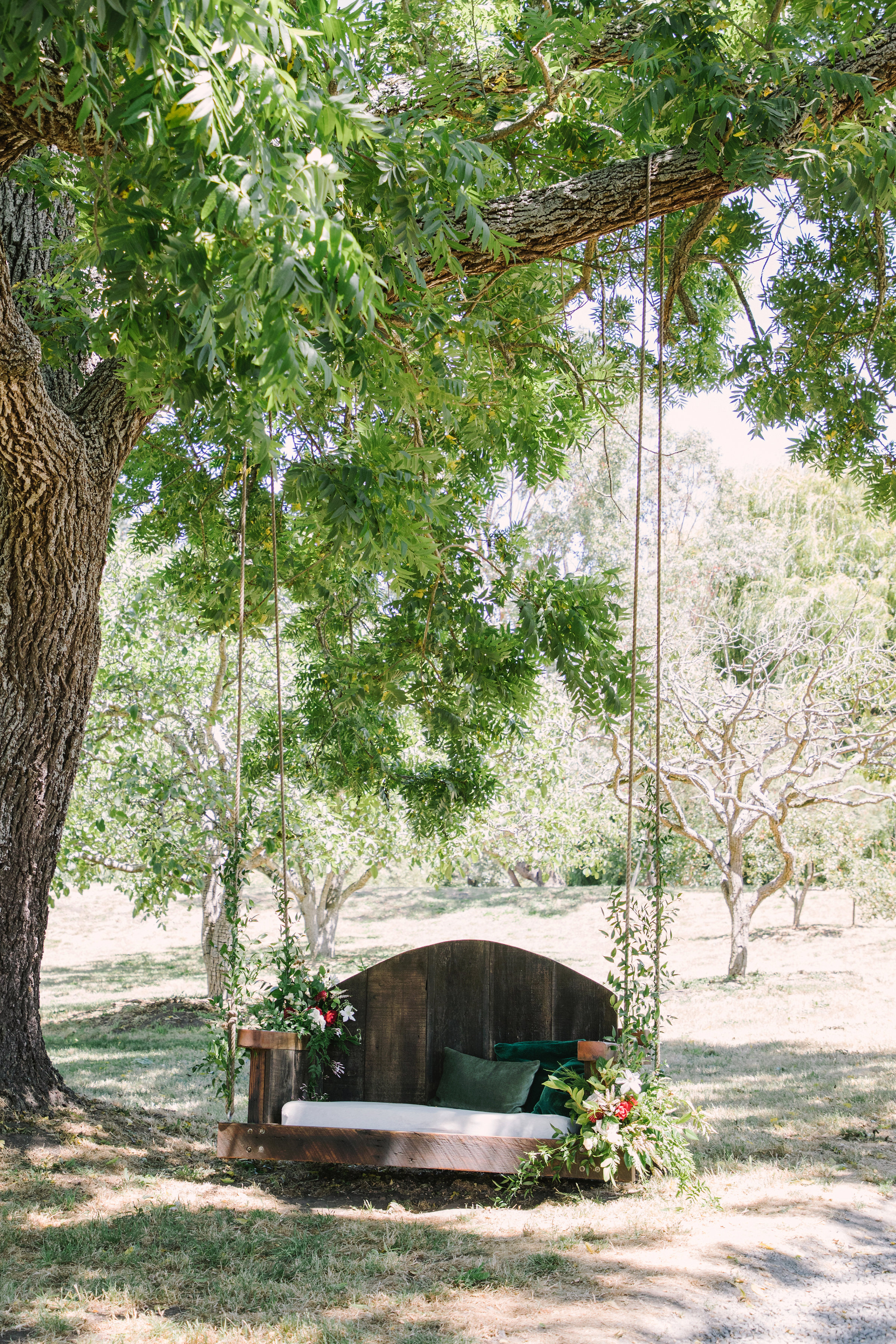 Boho wedding swing with flowers and vines by Venn Floral at Olympia's Valley Estate photographed by The Edges.