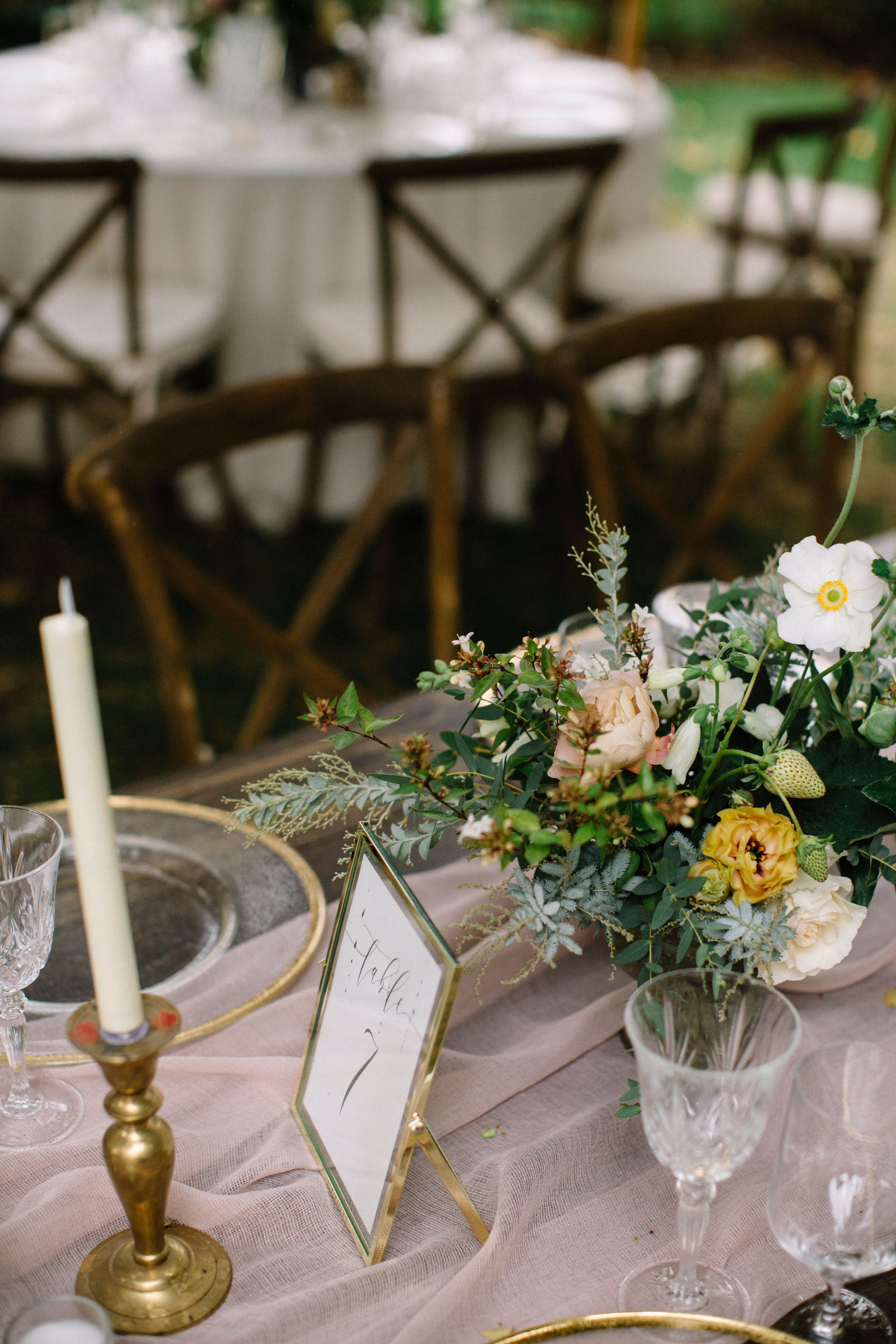 Elegant wild centerpiece with taper candles and vintage glassware by Venn Floral photographed by Lucille Lawrence in Healdsburg, California.