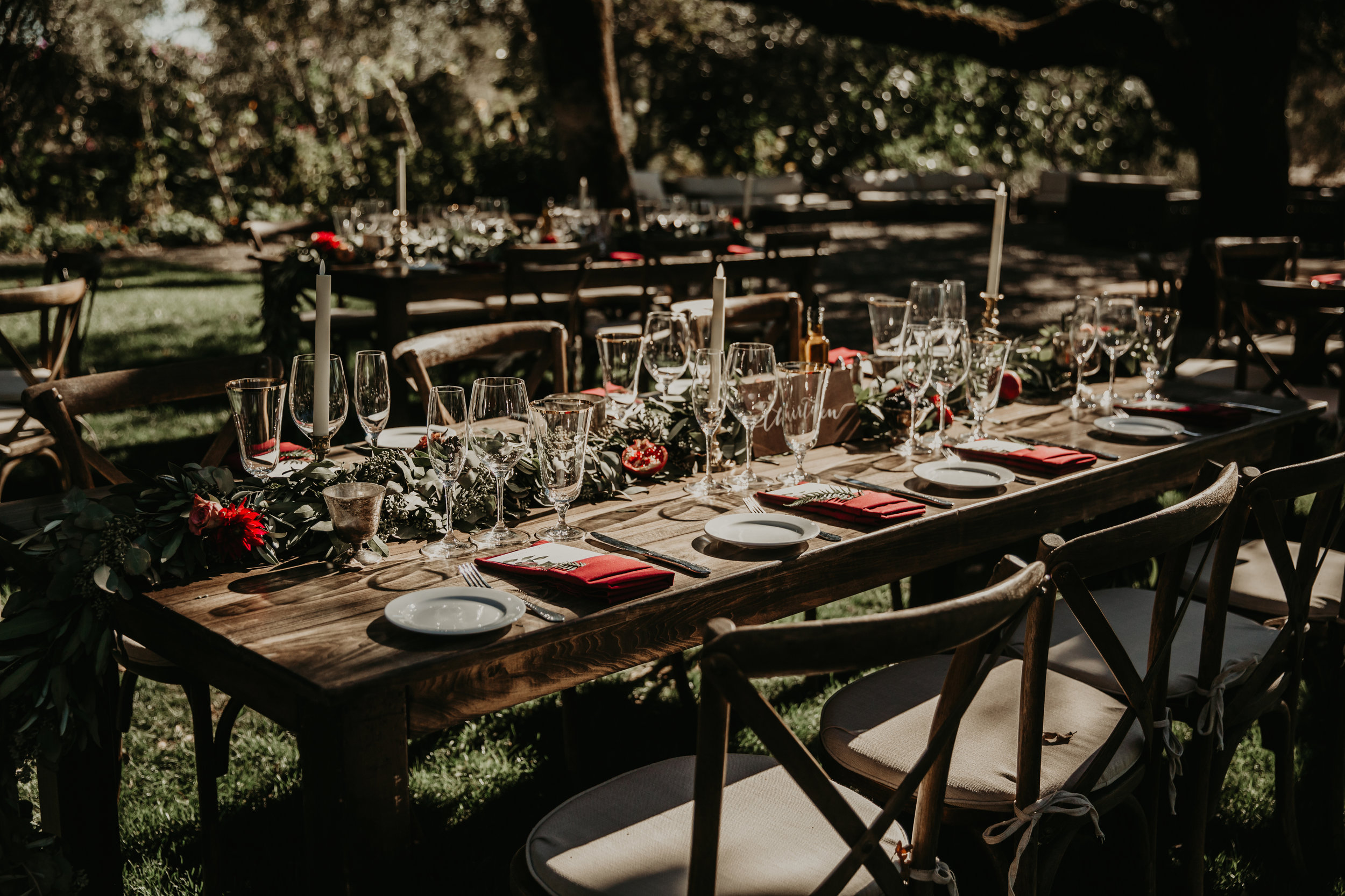 Greenery garlands, candlesticks,fruit, and flowers for a Boho California garden wedding by Venn Floral with Whitney Nelson Events at Beltane Ranch. Photographed by Vera Frances