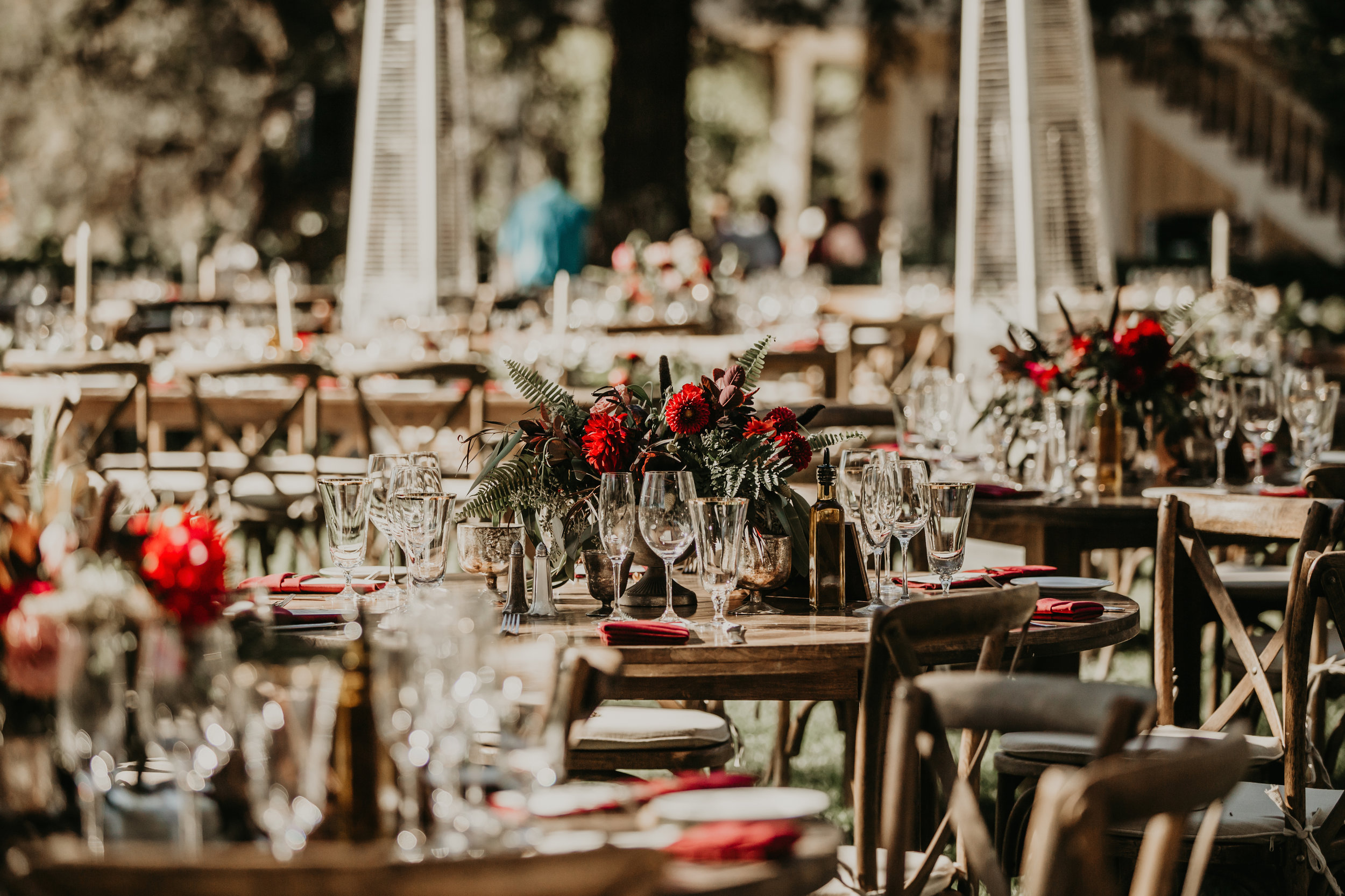 Plum and burgundy natural centerpieces by Venn Floral at Beltane Ranch with Whitney Nelson Events at Beltane Ranch. Photographed by Vera Frances