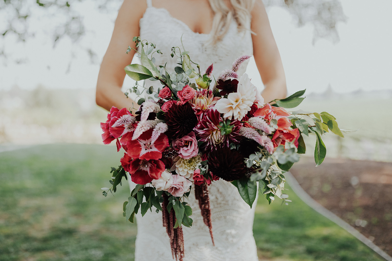 Cascading bridal bouquet in rich vibrant shades by Venn Floral for a stylish Summer wedding at Ru's Farm in Healdsburg photographed by Logan Cole.