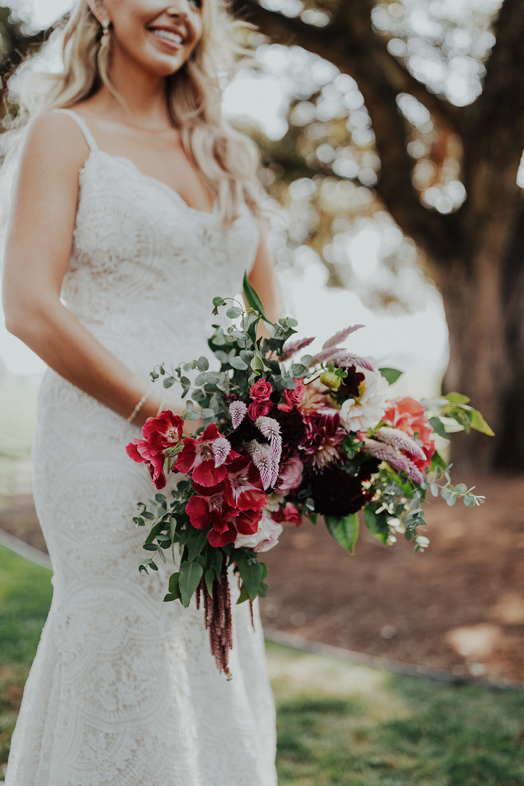 Rich and vibrant bridal bouquet in a lush and natural shape by Venn Floral at Ru's Farm in Healdsburg photographed by Logan Cole.