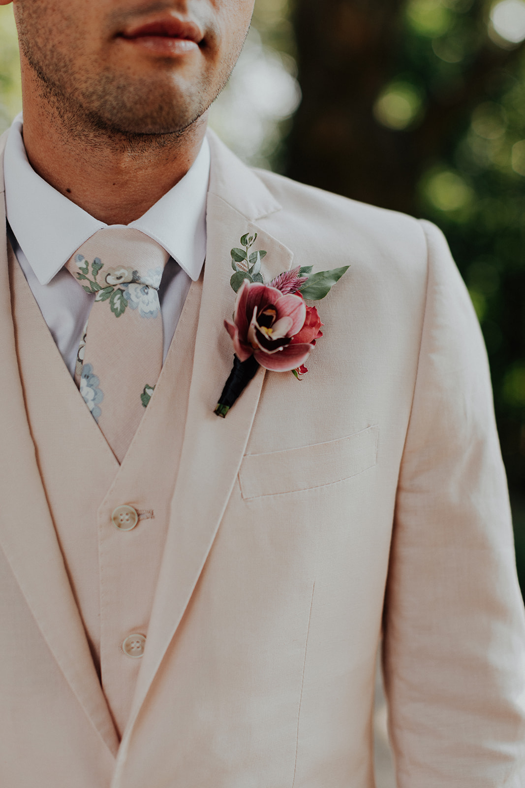 Bridesman boutonniere looking handsome against a pale pink suit. Healdsburg wedding florist, Venn Floral, at Ru's Farm photographed by Logan Cole.