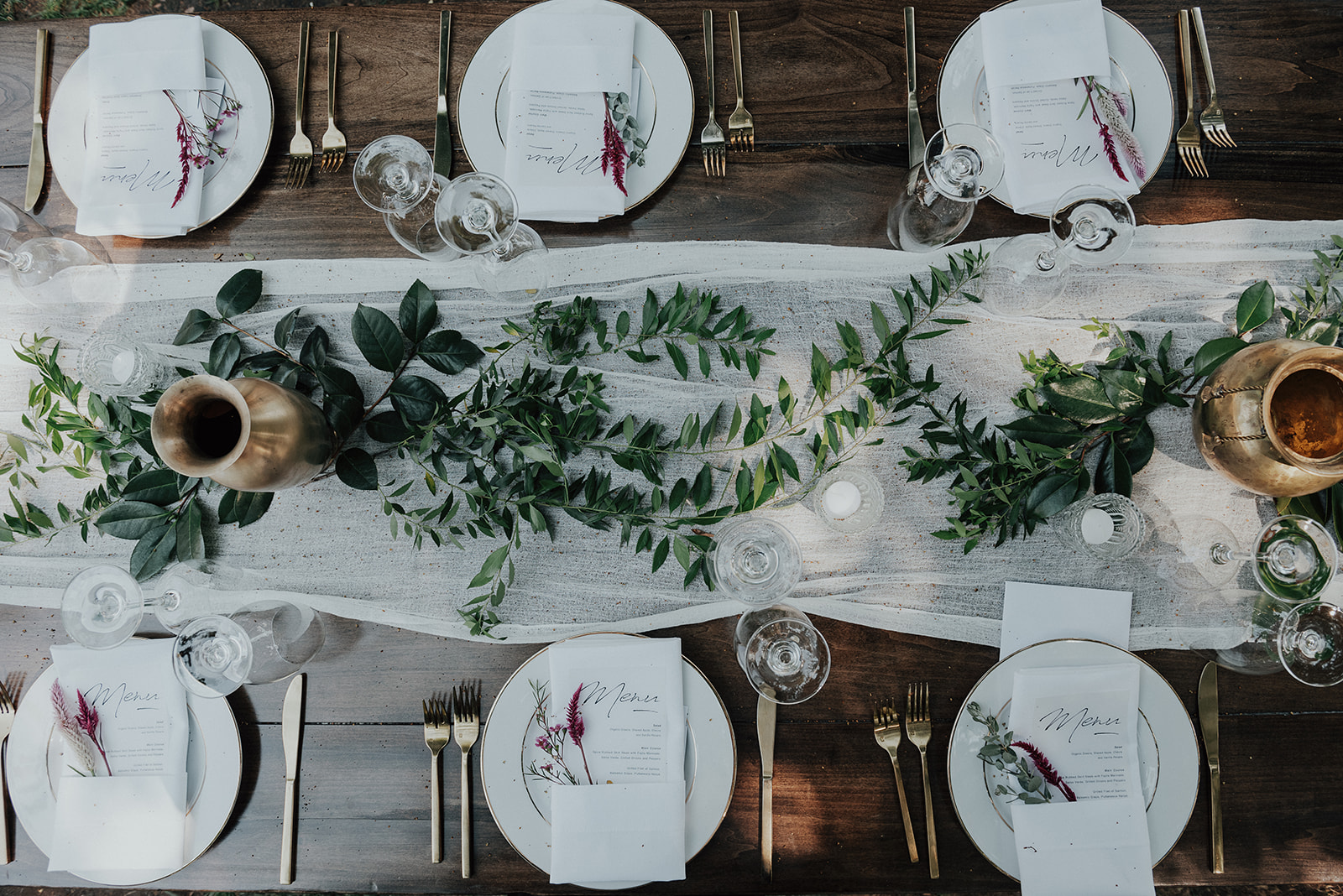 Greenery runner and gold vases to repurpose bridal bouquets at the head table. Healdsburg wedding flowers by Venn Floral at Ru's Farm photographed by Logan Cole.
