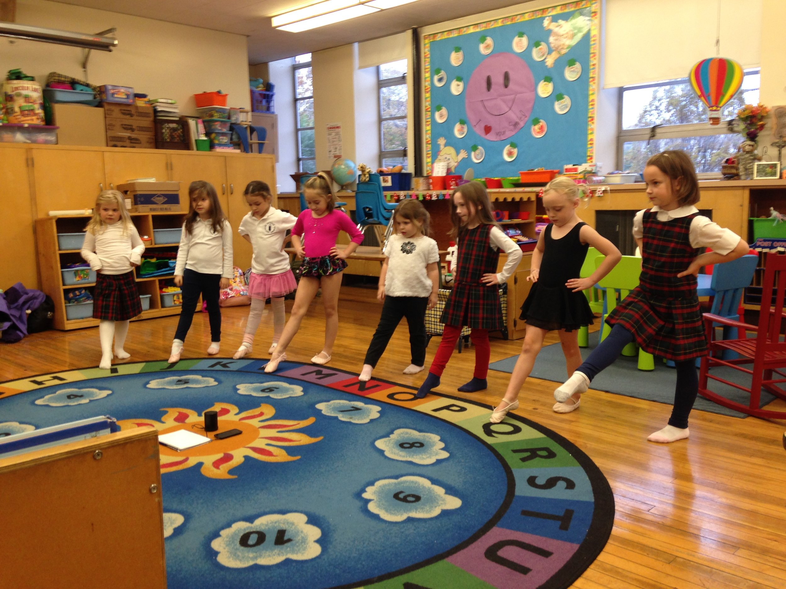 Northside Catholic Academy Students in Ms. Laura's Storytime Ballet Show of their point skills!