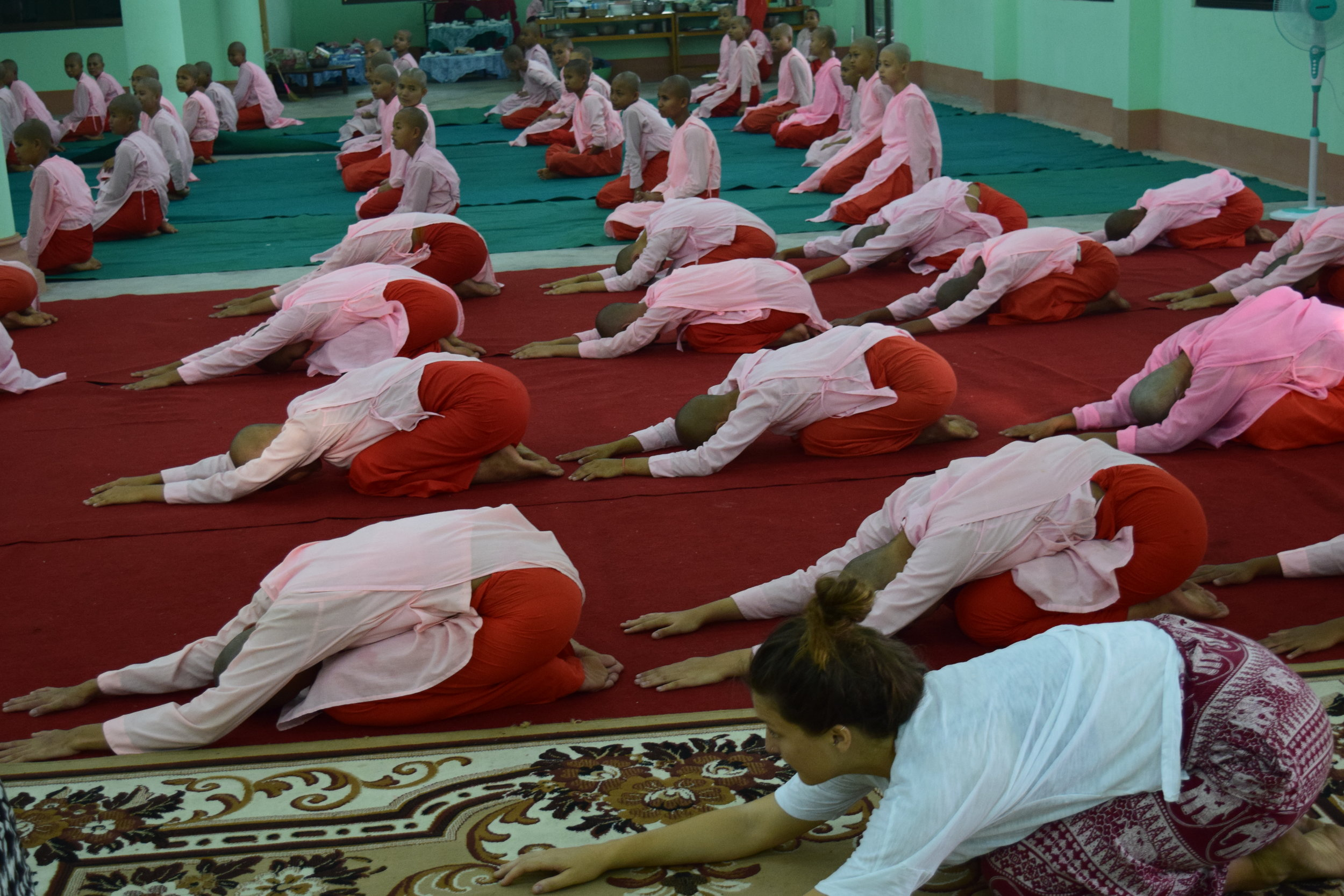 Carly leading  Balasana  (child's pose) at the nunnery in 2016