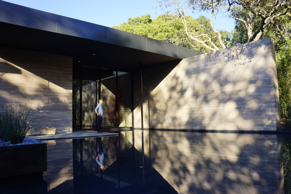 A leader of the Windhover Contemplative Center project at Stanford admires the finished building.