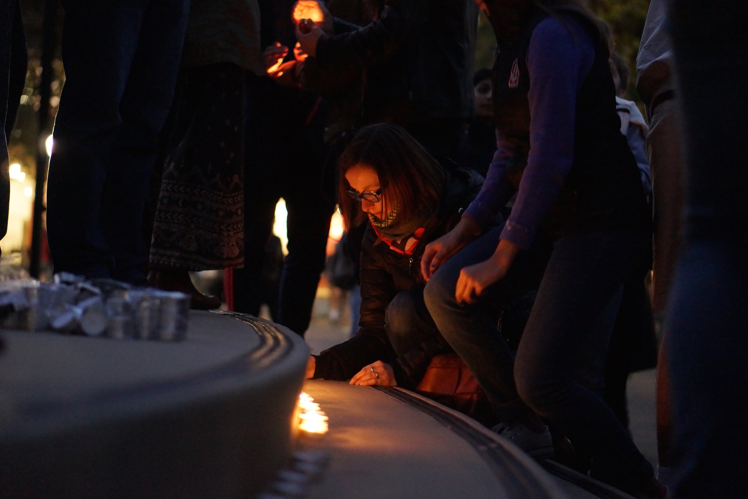 Students held an unofficial vigil in White Plaza on Sunday evening, in memory of recent terror attacks in Baghdad, Beirut and Paris.